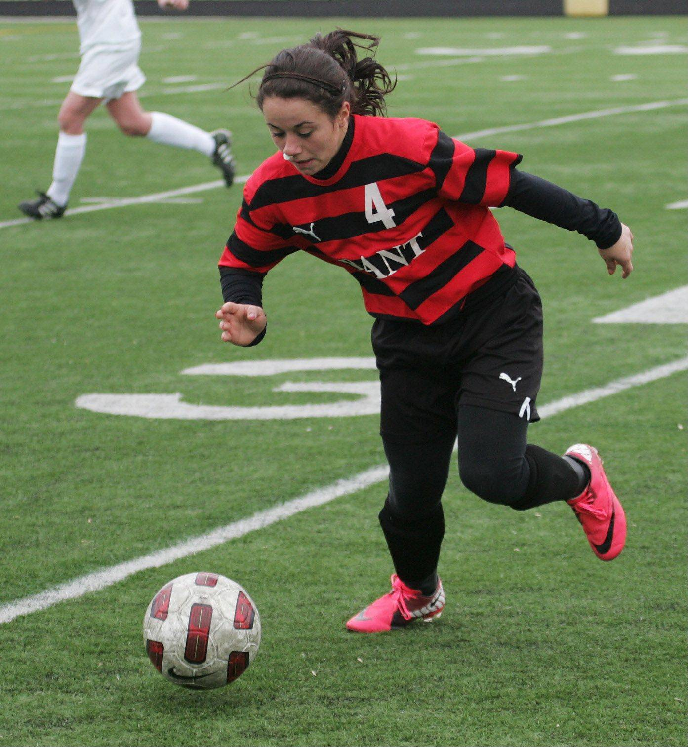 Grant midfielder Nina Deliglio dribbles against host Grayslake Central on Wednesday.