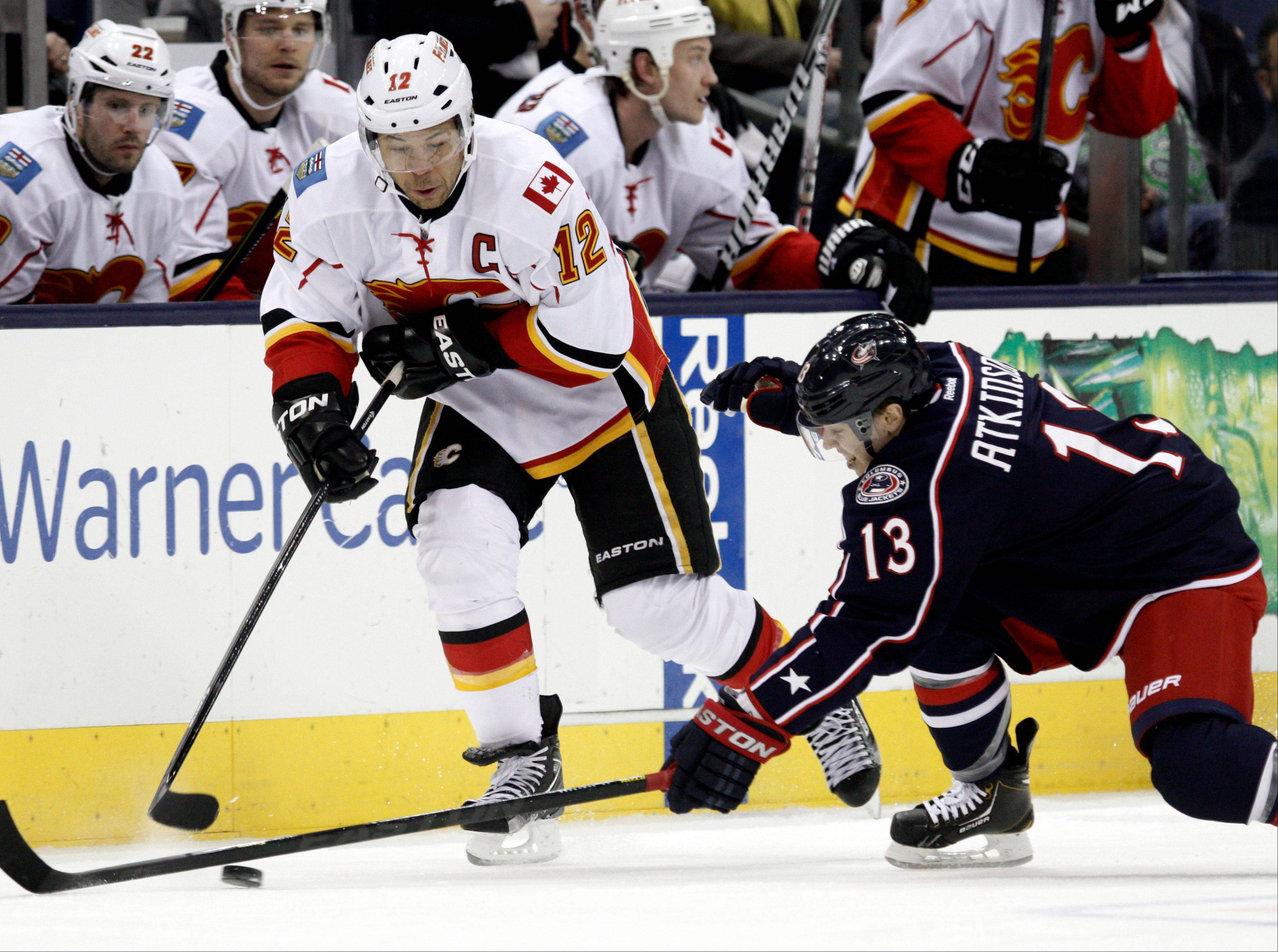 Calgary's Jarome Iginla, left, has reportedly been dealt to Pittsburgh for two prospects and a first-round draft pick.