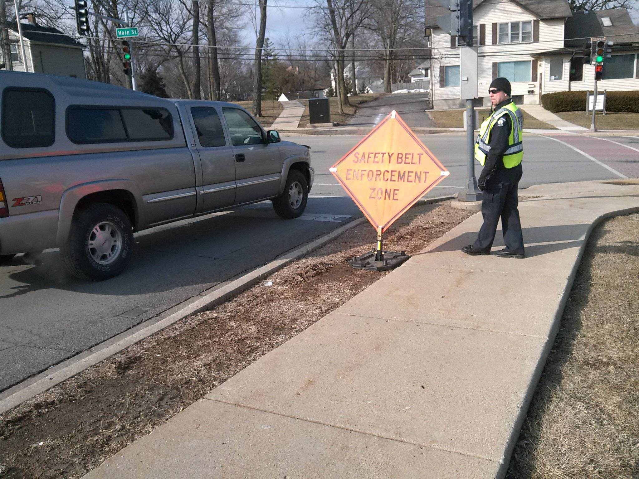 One of West Chicago's Finest checks passing cars for seatbelt safety during Safety Campaign #3.