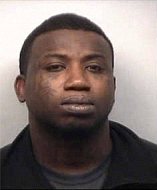 Rapper Gucci Mane, whose real name is Radric Davis, appears in a booking photo. Mane was being held in jail on an assault charge after a fan told police the artist smashed a champagne bottle on his head March 16 in a downtown Atlanta nightclub. Mane was in custody early Wednesday on a charge of aggravated assault with a weapon.