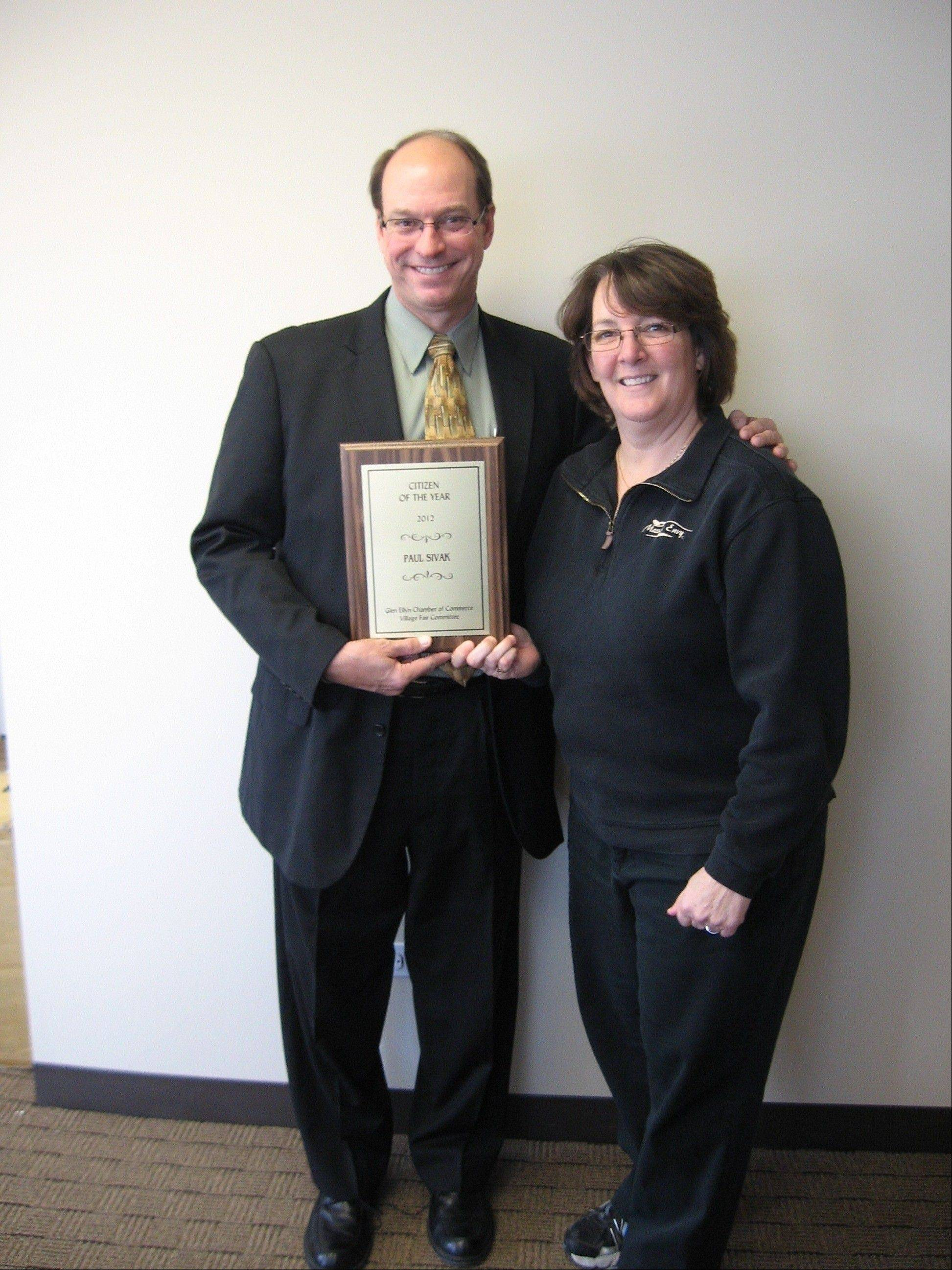 Paul Sivak of Precision Payroll and the 2012 president of the Glen Ellyn Chamber of Commerce was awarded Citizen of the Year at the Glen Ellyn Community Awards. He is pictured with Katie Cass of Massage Envy Spa, the chamber�s 2013 president.