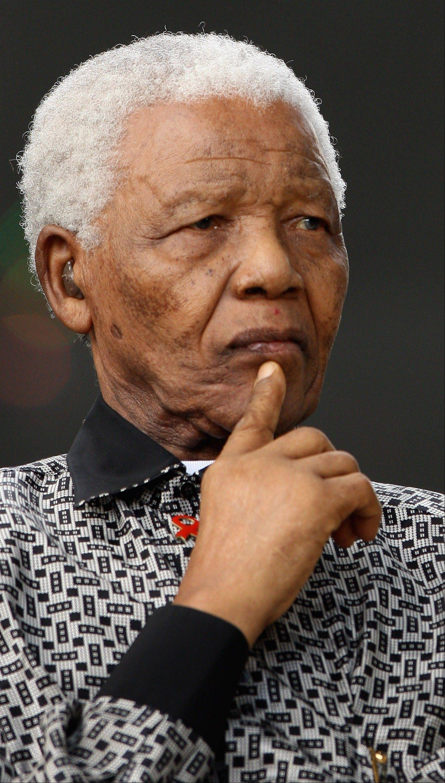 Former South African President Nelson Mandela pauses during a statue unveiling ceremony in his honor at Parliament Square in London.
