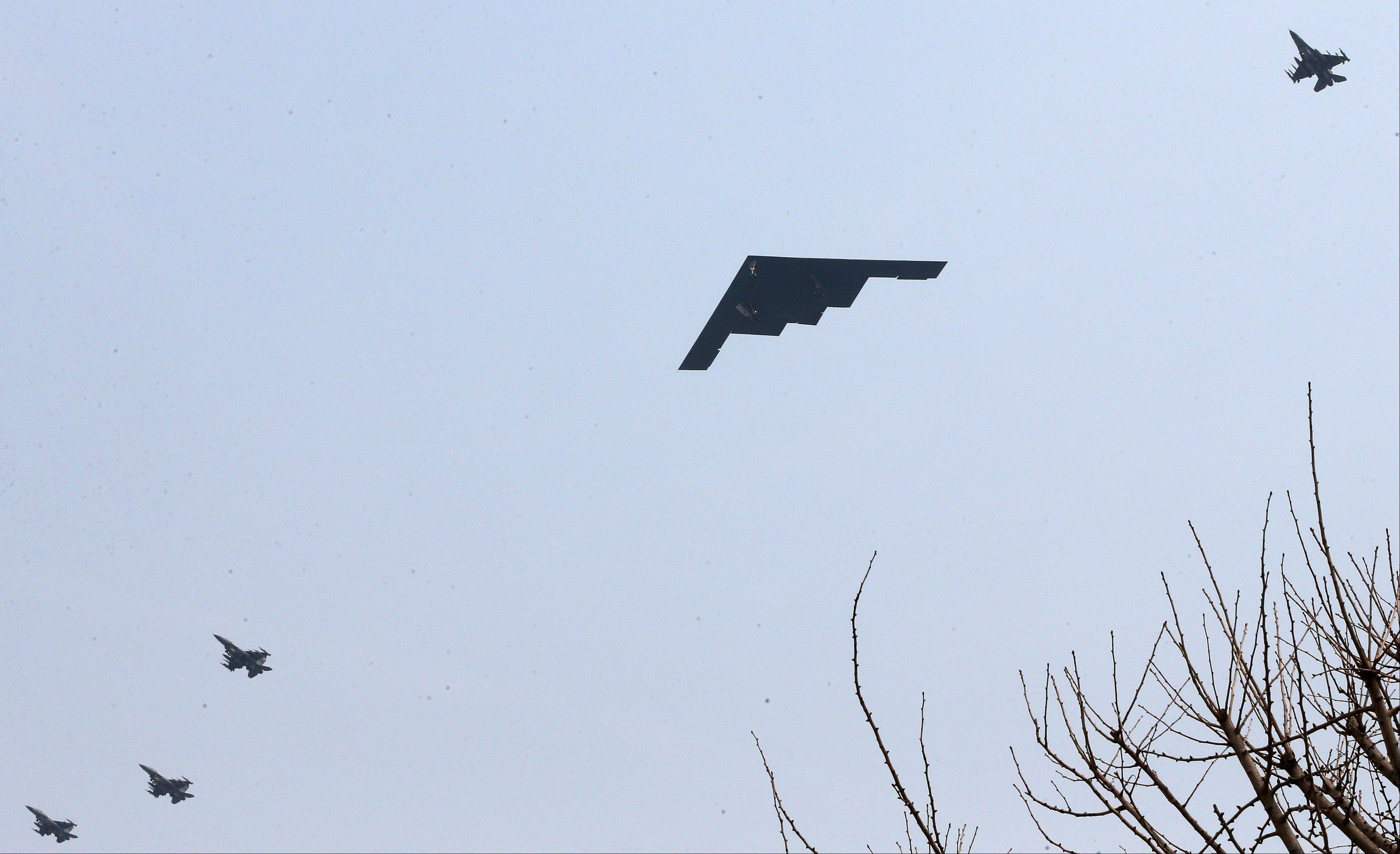 U.S. Air Force B-2 stealth bomber flies over near Osan U.S. Air Base in Pyeongtaek, south of Seoul, South Korea, Thursday.