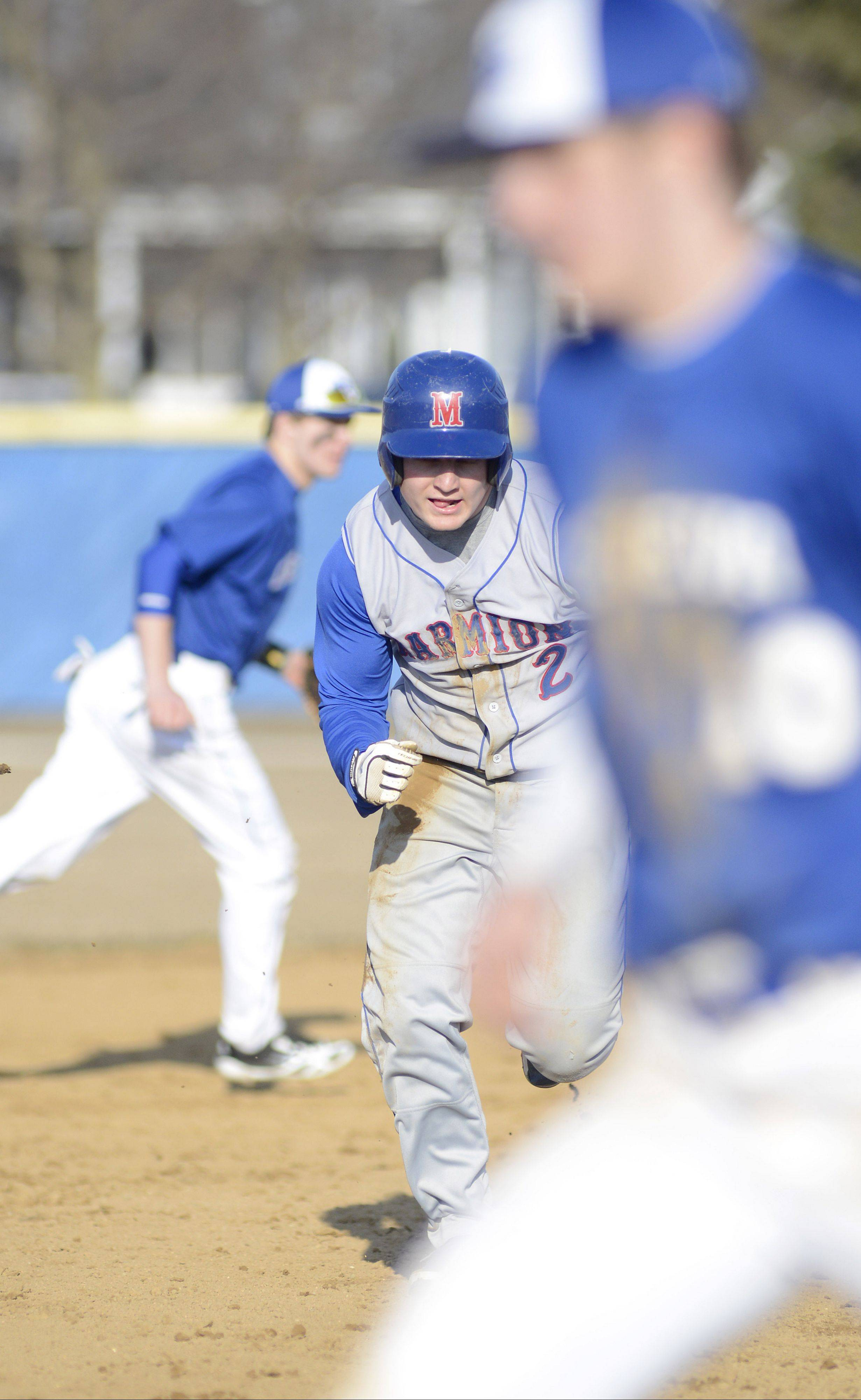 Marmion�s RJ Gibson bolts to third base trying to beat the throw to Geneva�s Mitchell Endriukaitis.