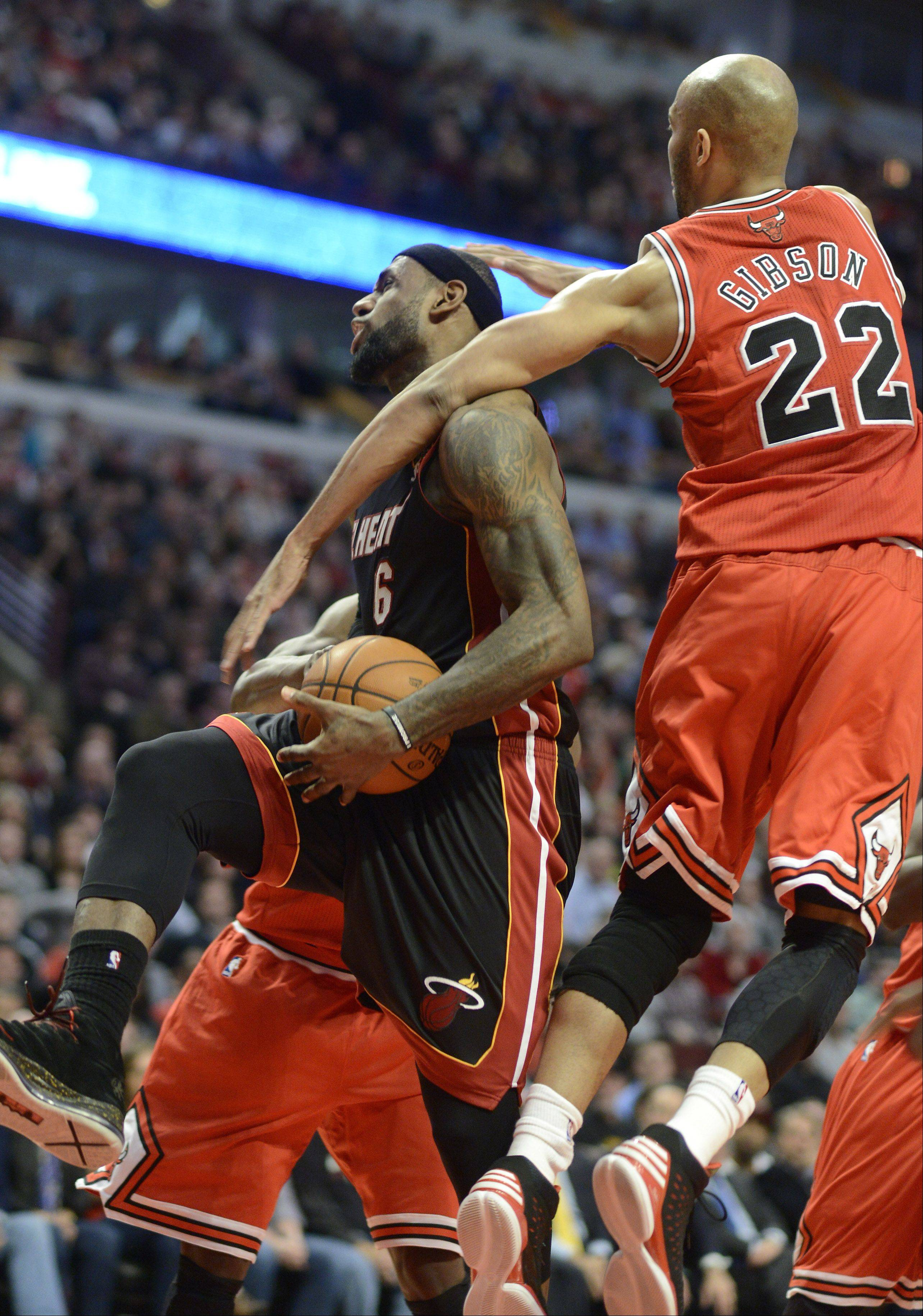 The Heat�s LeBron James gets fouled by Taj Gibson of the Bulls. It was reviewed and determined not to be a flagrant foul.