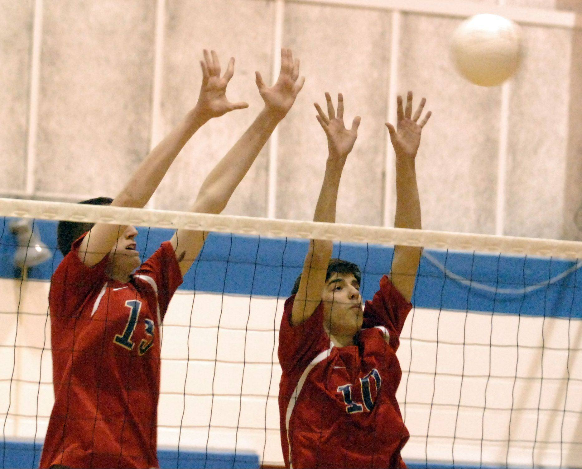 South Elgin�s Ian Saxton, left, and Chris Gibadlo go up for a block against Larkin earlier this season.