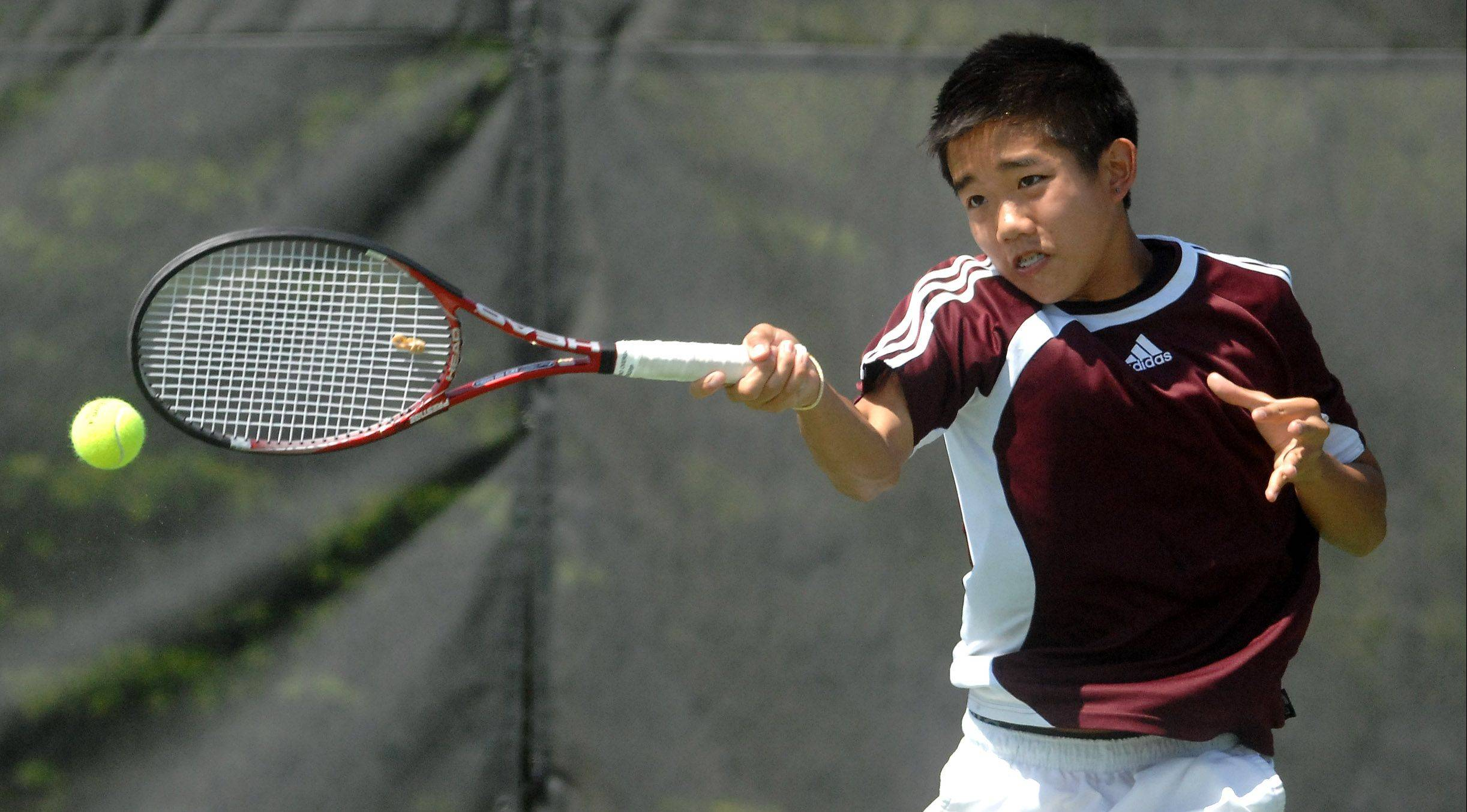Elgin�s Eric Chai returns serve against St. Charles North during the Upstate Eight River Division tournament last season. Chai is a returning state qualifier.
