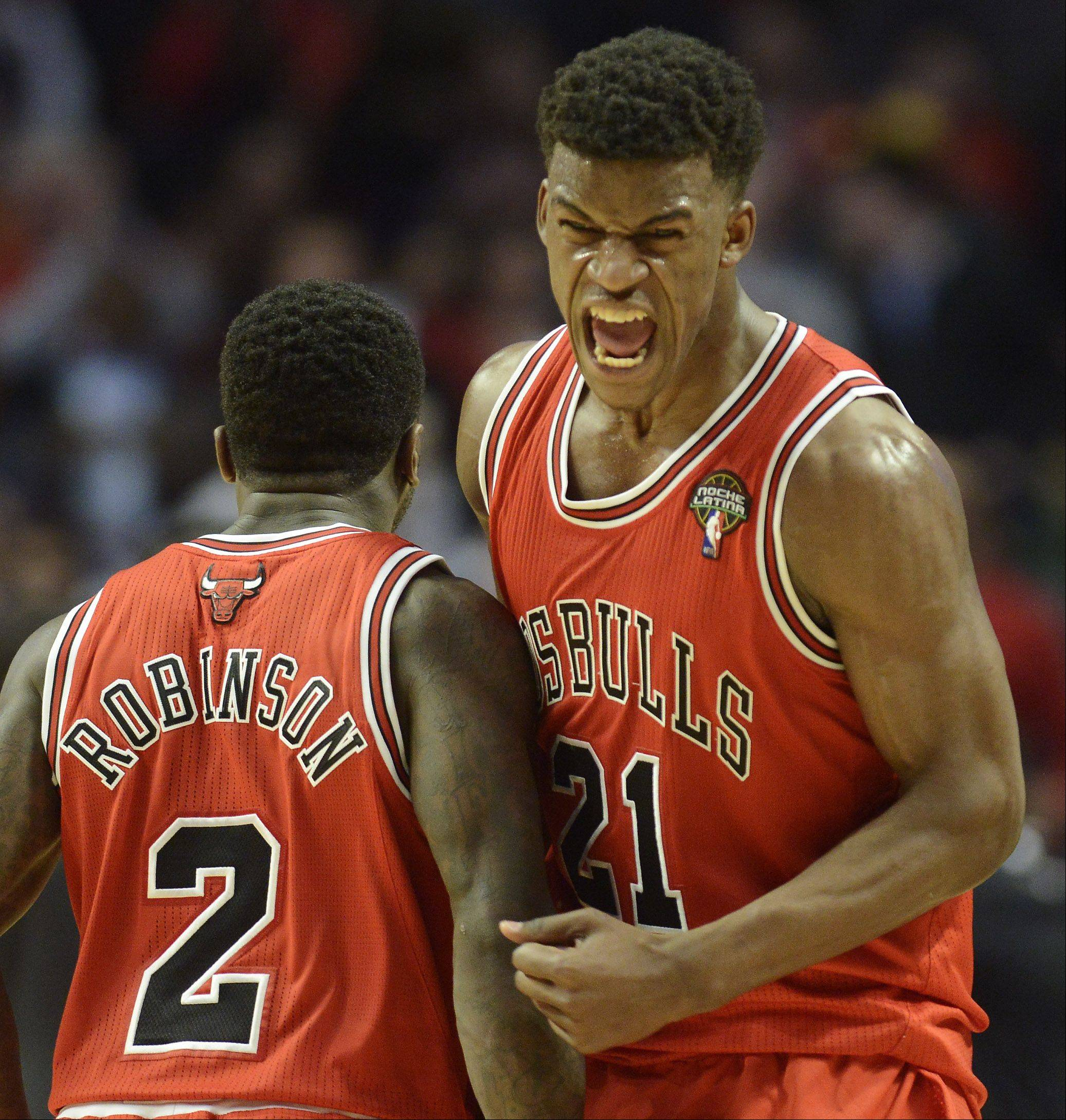 Jimmy Butler of the Bulls celebrates a big dunk against the Heat Wednesday.