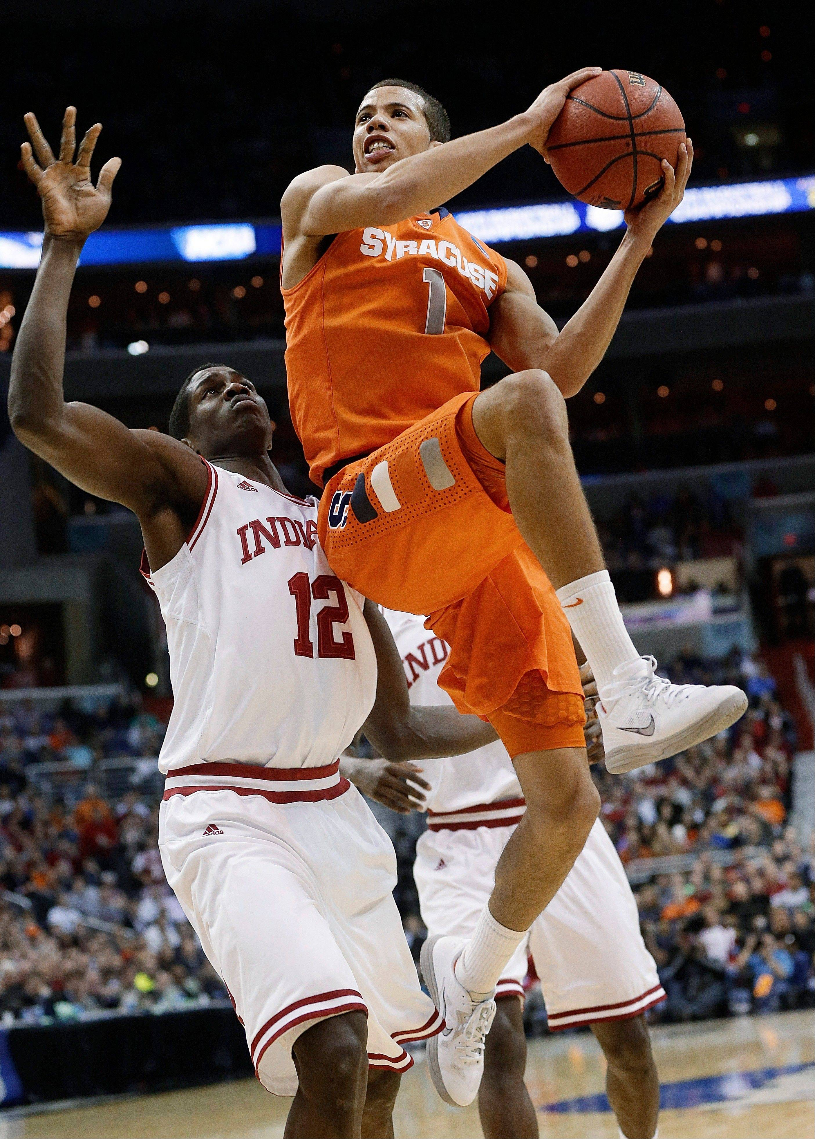 Syracuse guard Michael Carter-Williams (1) goes up past Indiana forward Hanner Mosquera-Perea (12) during the second half of an East Regional semifinal in the NCAA men's college basketball tournament, Thursday, March 28, 2013, in Washington. (AP Photo/Pablo Martinez Monsivais)
