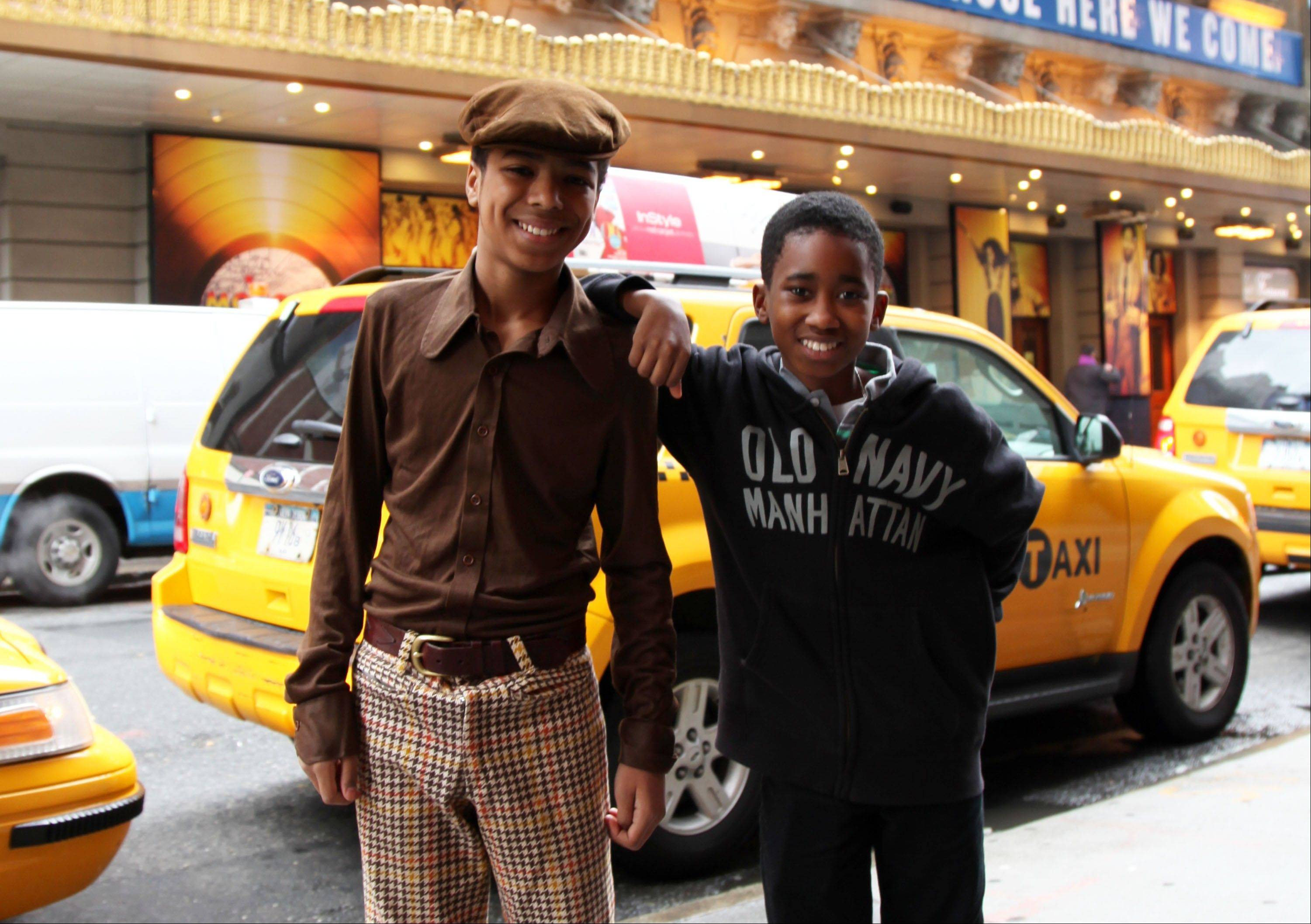 "Jibreel Mawry, left, and Raymond Luke Jr. pose outside the Lunt-Fontanne Theatre in New York, where their show ""Motown: The Musical,"" is playing. The two 12-year-olds are alternating taking on the roles of young Michael Jackson, young Stevie Wonder and a young Berry Gordy."