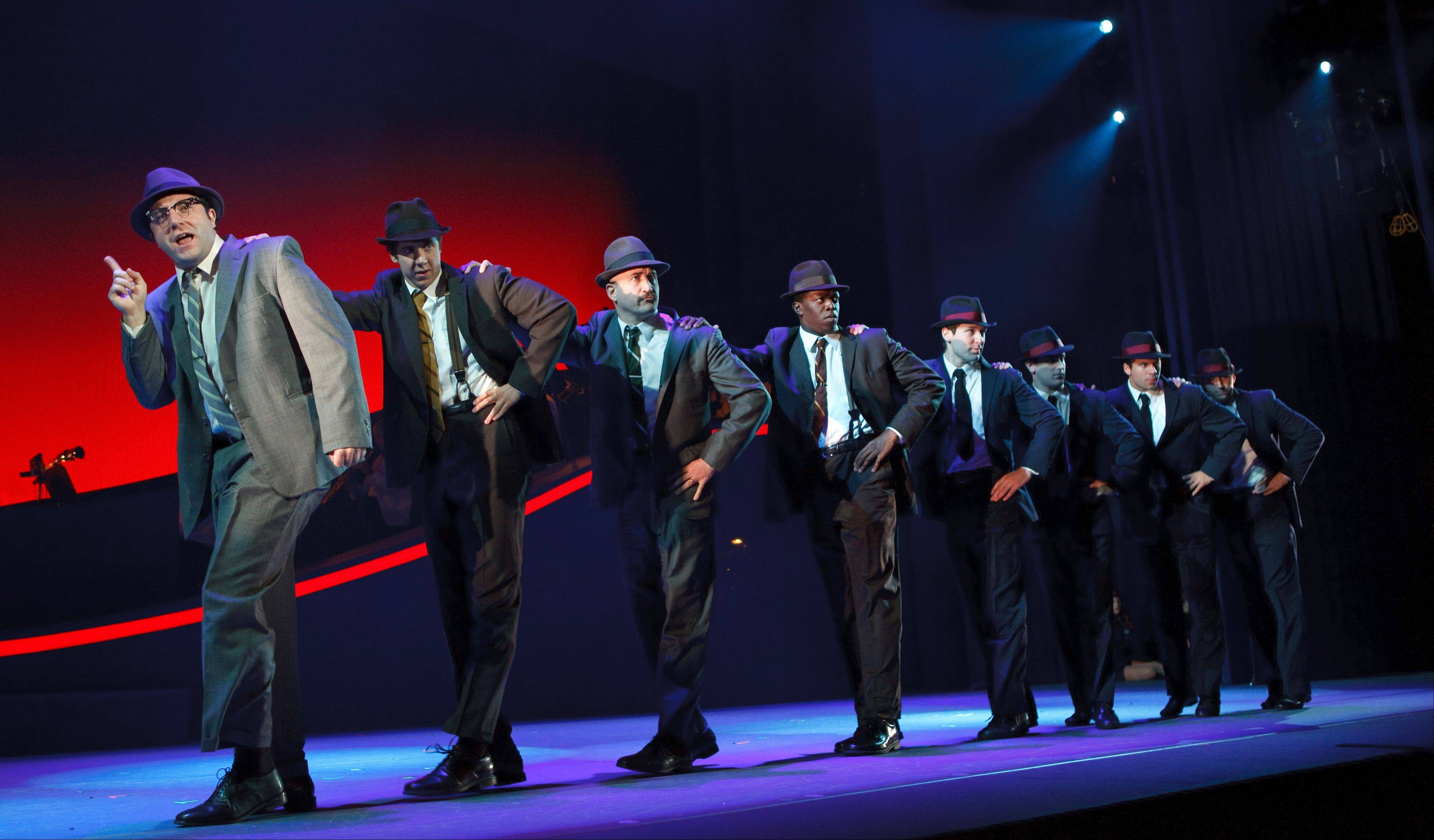 "Ben Laxton, second from left, plays Agent Dollar in the touring version of the 2011 Broadway musical ""Catch Me If You Can"" at the Cadillac Palace Theatre in Chicago."