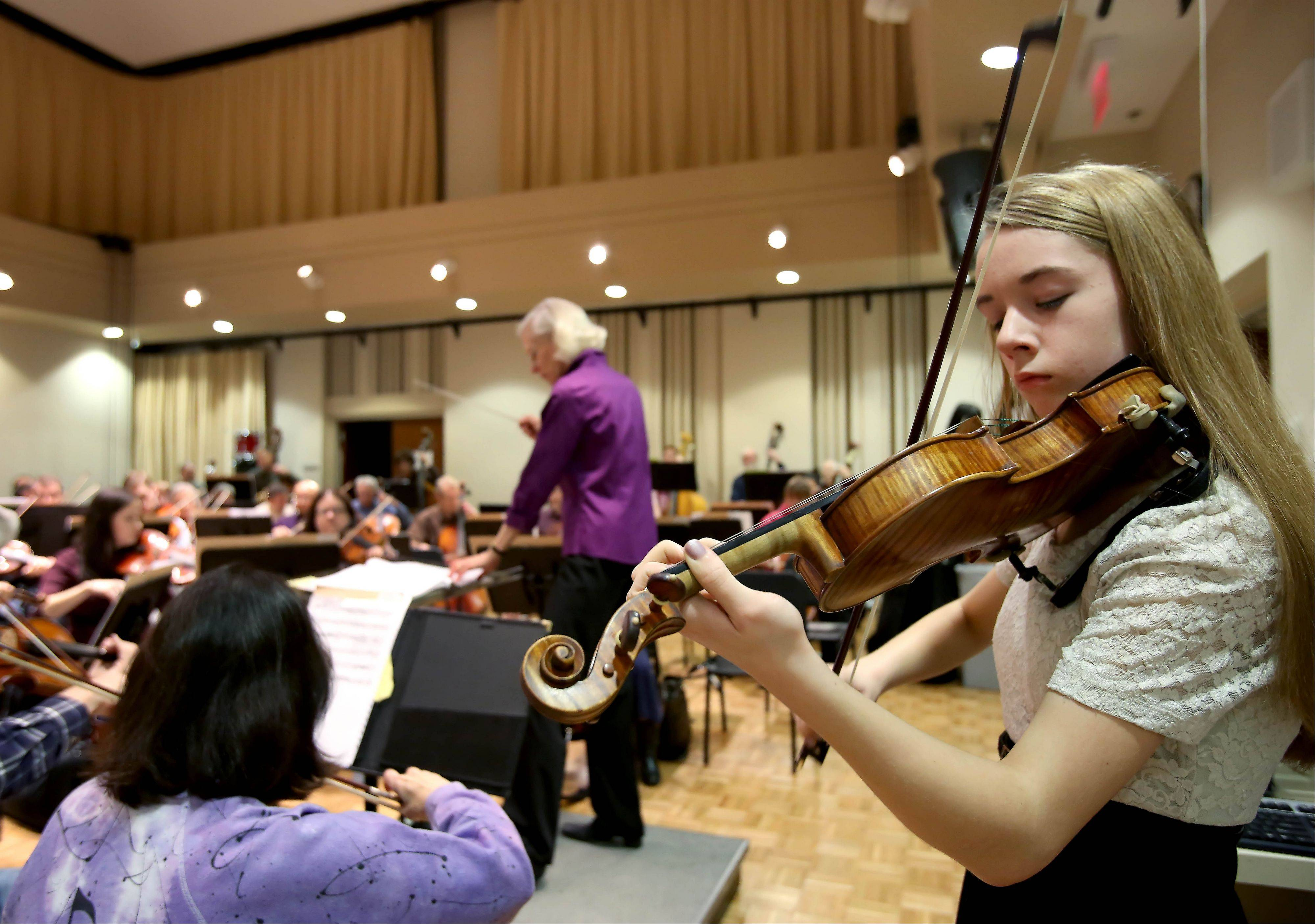 Serena Harnack, 14, of Glen Ellyn, practices her solo with the DuPage Symphony Orchestra at Wentz Hall in Naperville. She performed with the orchestra May 16 after winning a student competition.