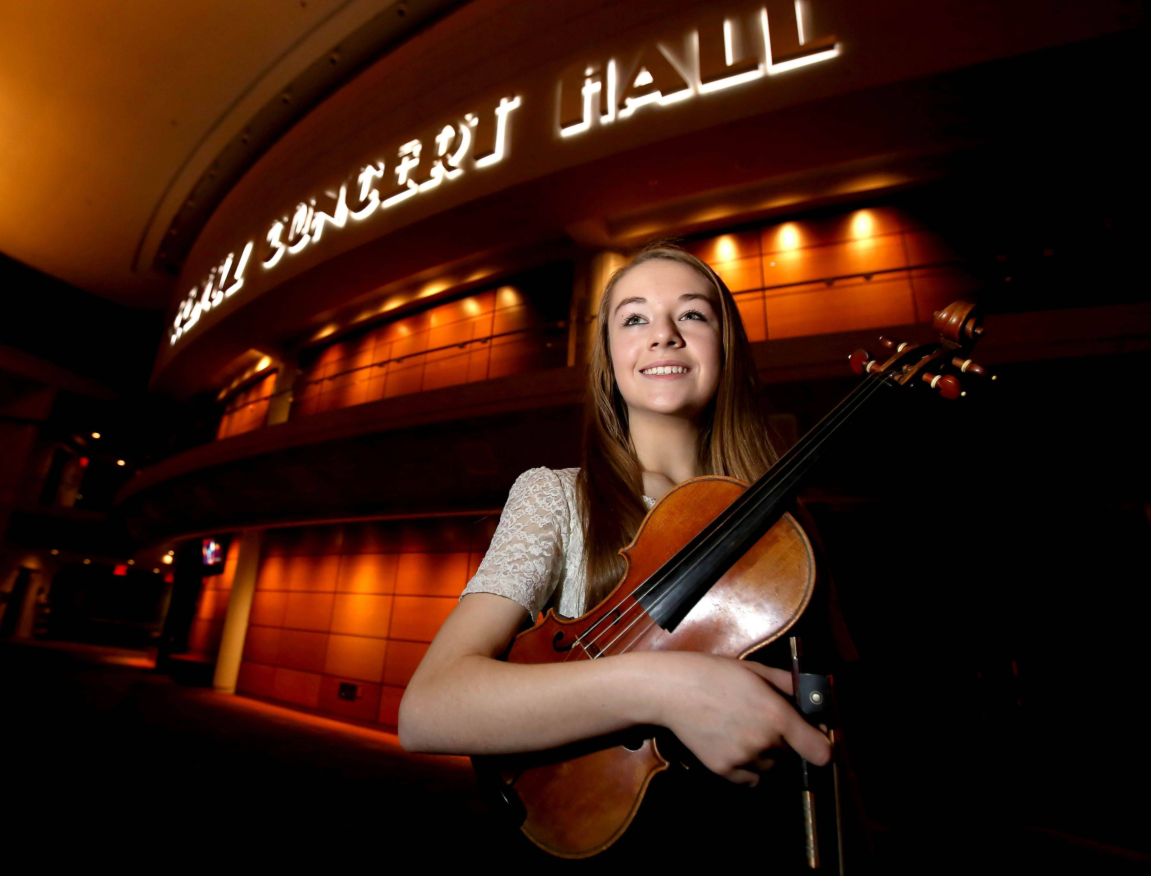 "Serena Harnack, 14, of Glen Ellyn, is making a name for herself in the Chicago area, earning solo performances with several symphony orchestras. ""I'm really speaking to the audience when I play,"" she said."