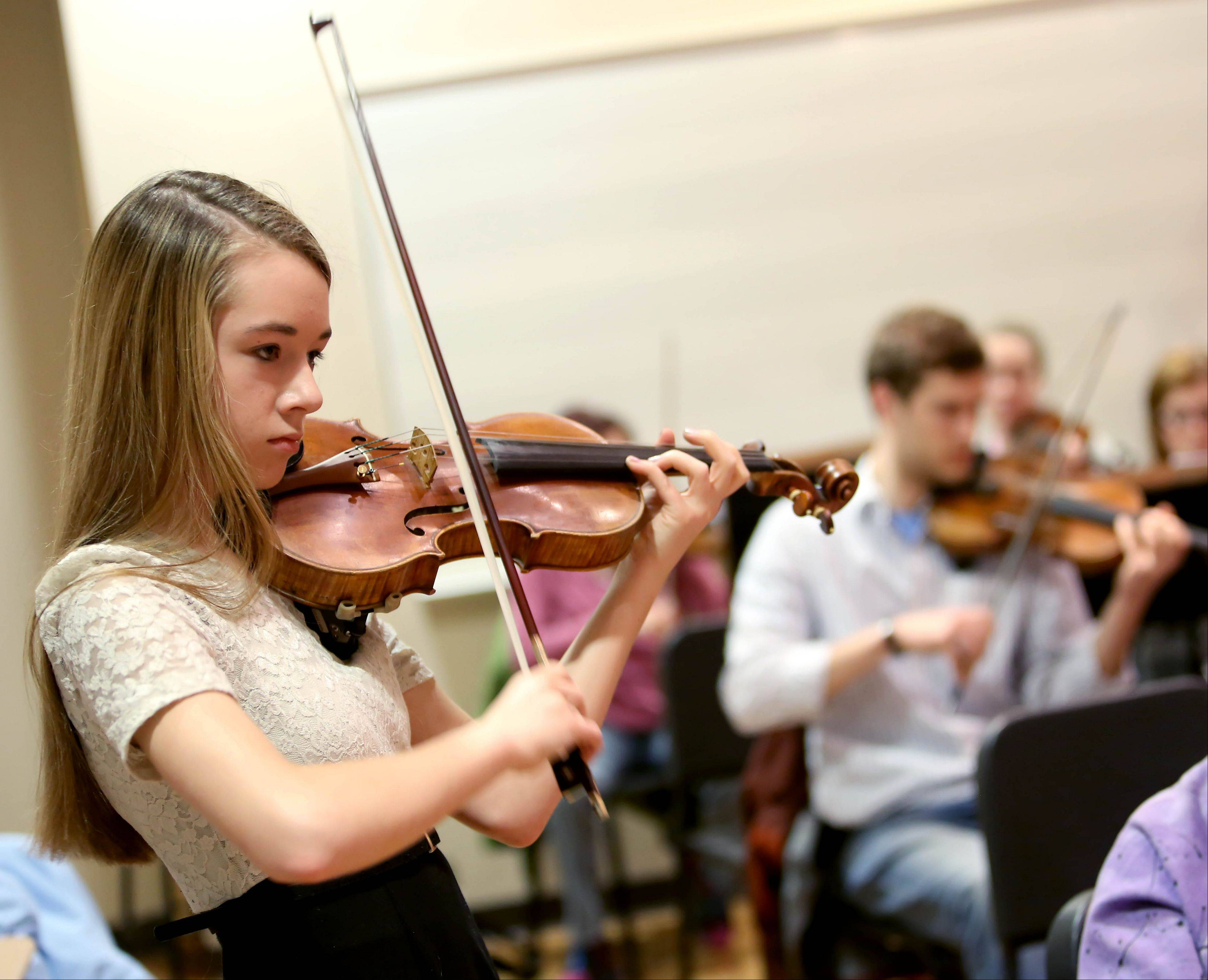 Serena Harnack of Glen Ellyn, 14, practices her solo with the DuPage Symphony Orchestra at Wentz Hall in Naperville. She performed with the orchestra May 16 after winning a student competition.