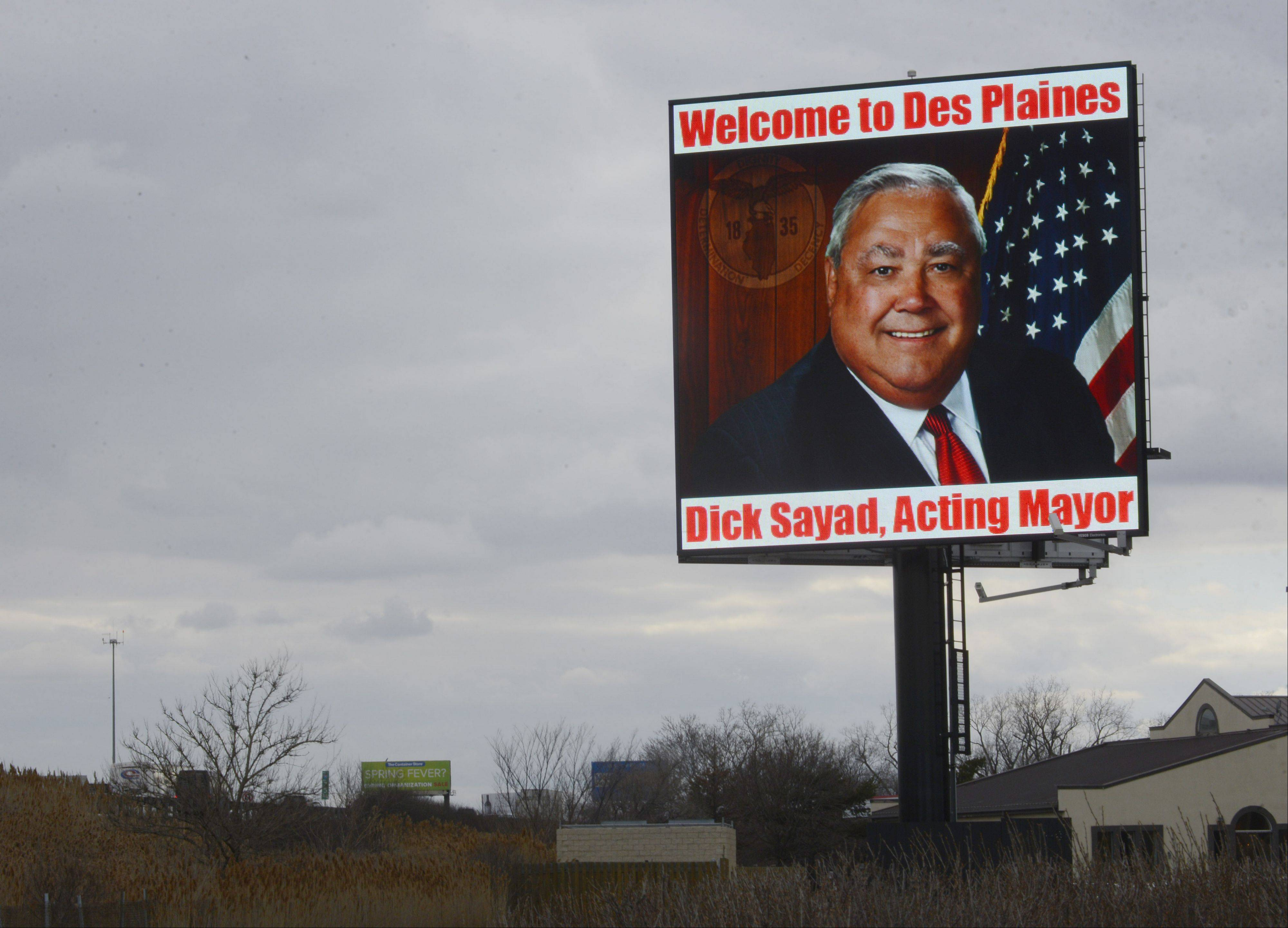 JOE LEWNARD/jlewnard@dailyherald.comA lighted billboard which can be seen by motorists traveling on the westbound Jane Addams Tollway includes a message from acting Des Plaines Mayor Dick Sayad welcoming them to Des Plaines. Sayad holds the job for seven weeks.