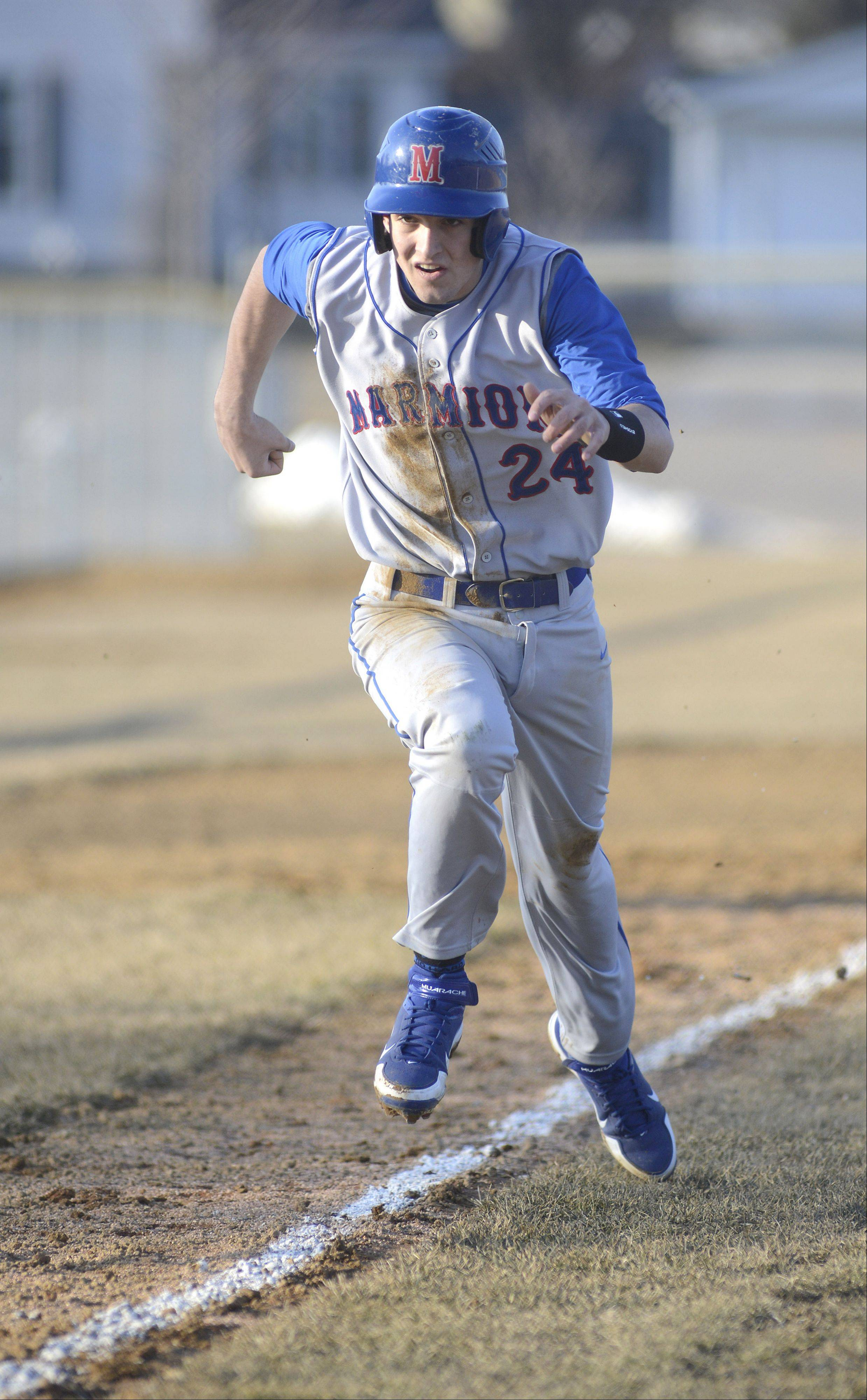 Marmion's Corey Friel bolts for home base to score a run in the seventh inning on Thursday, March 28.