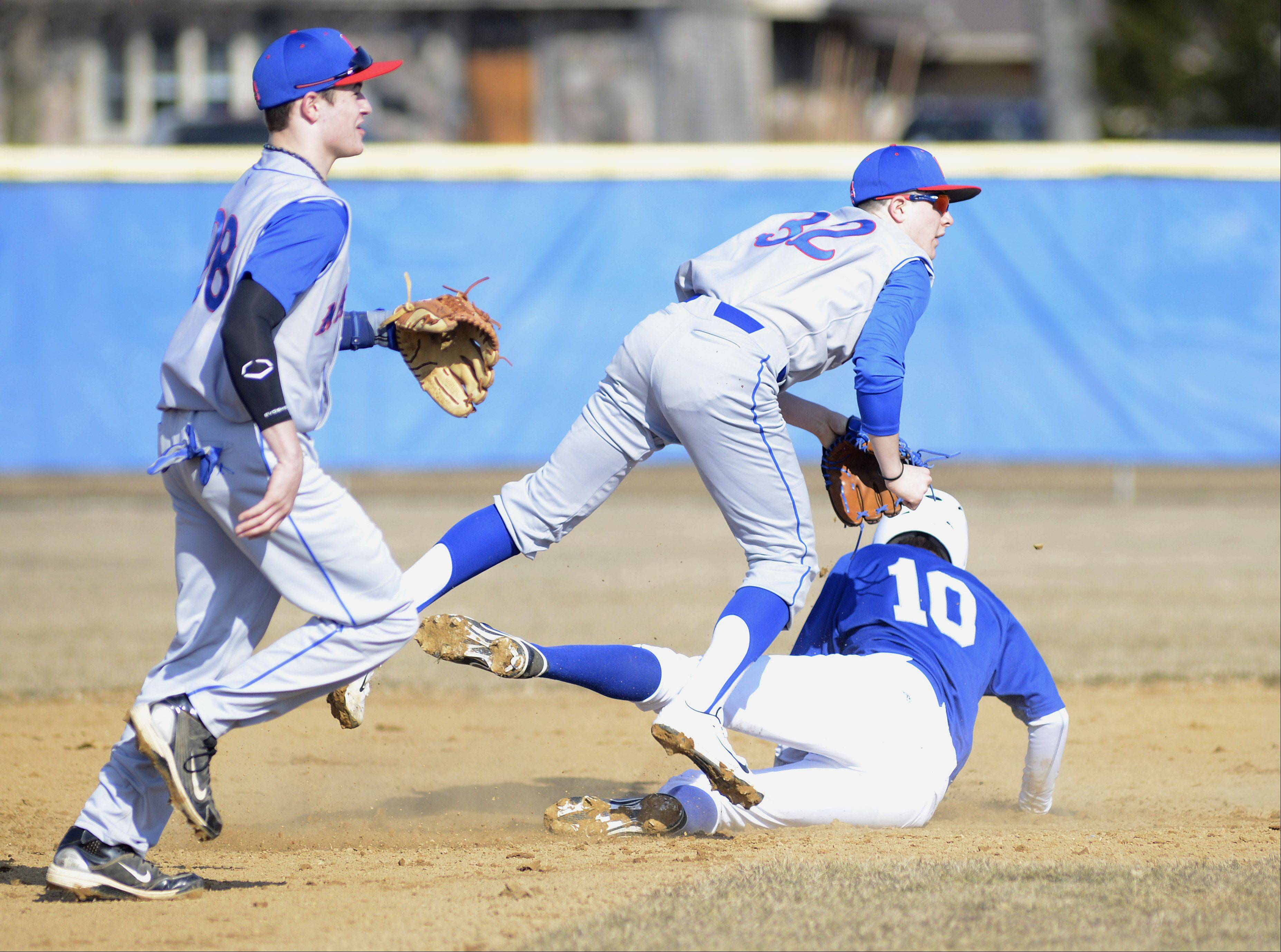 Geneva's Mitchell Endriukaitis is tagged out at second base by Marmion's Edgar Sanchez in the first inning on Thursday, March 28.