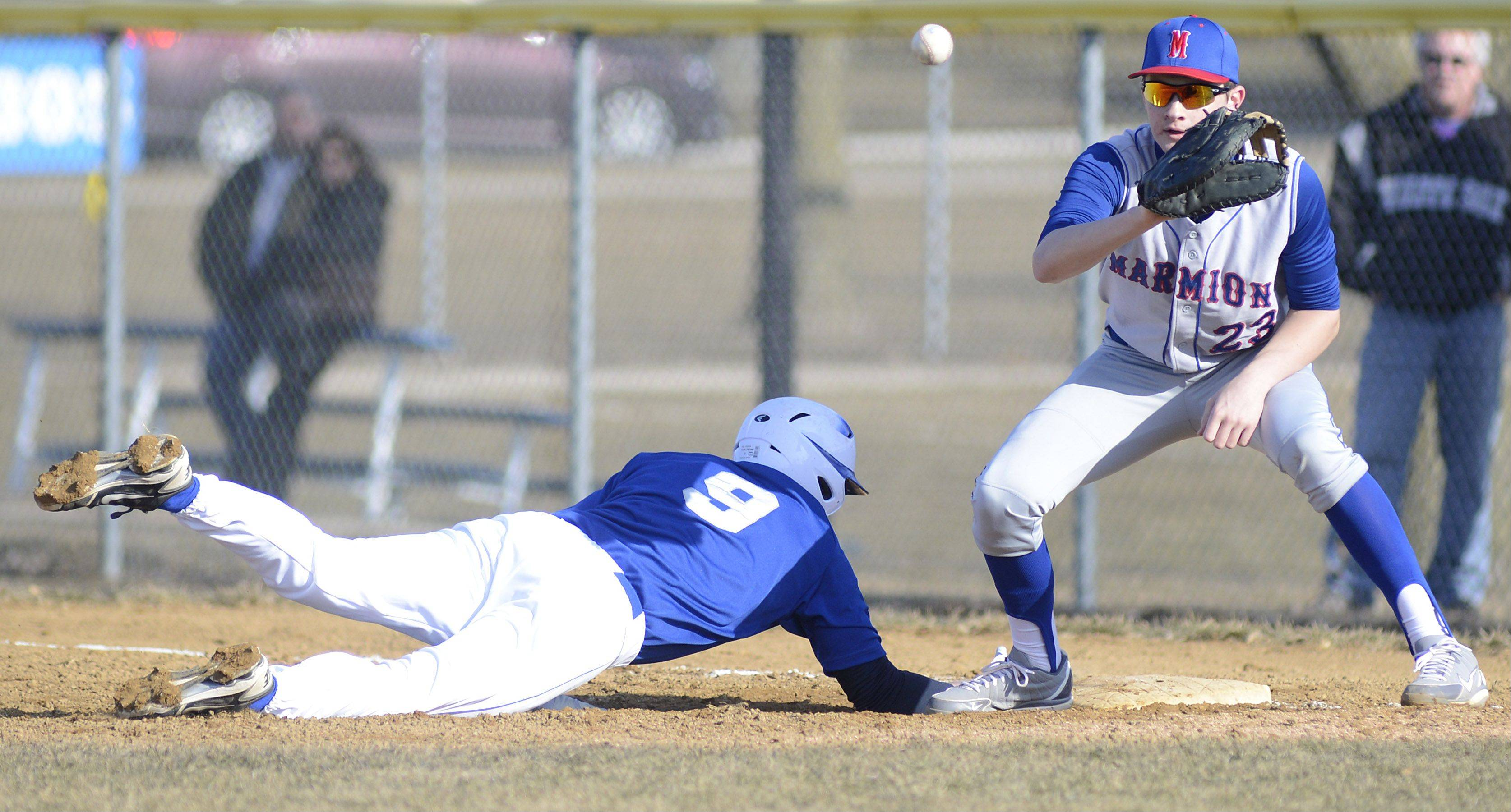 Geneva's Dan Berendt is safe back at first base from Marmion's Alex Troop in the second inning on Thursday, March 28.