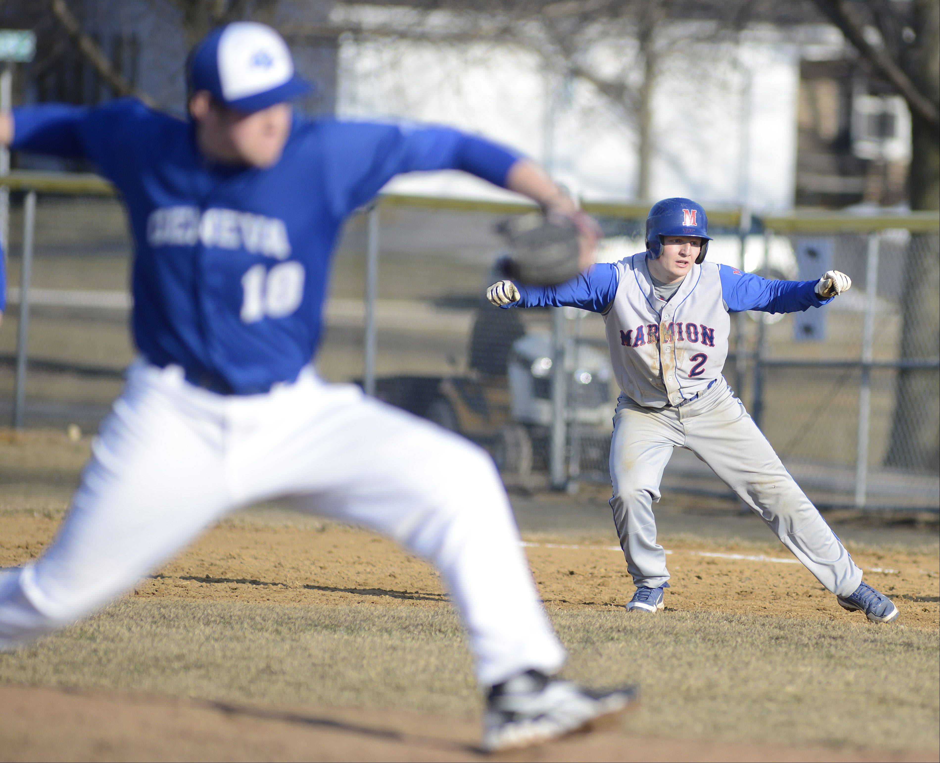 Marmion's RJ Gibson looks to steal second base while Geneva's Tony Landi pitches in the fifth inning on Thursday, March 28.
