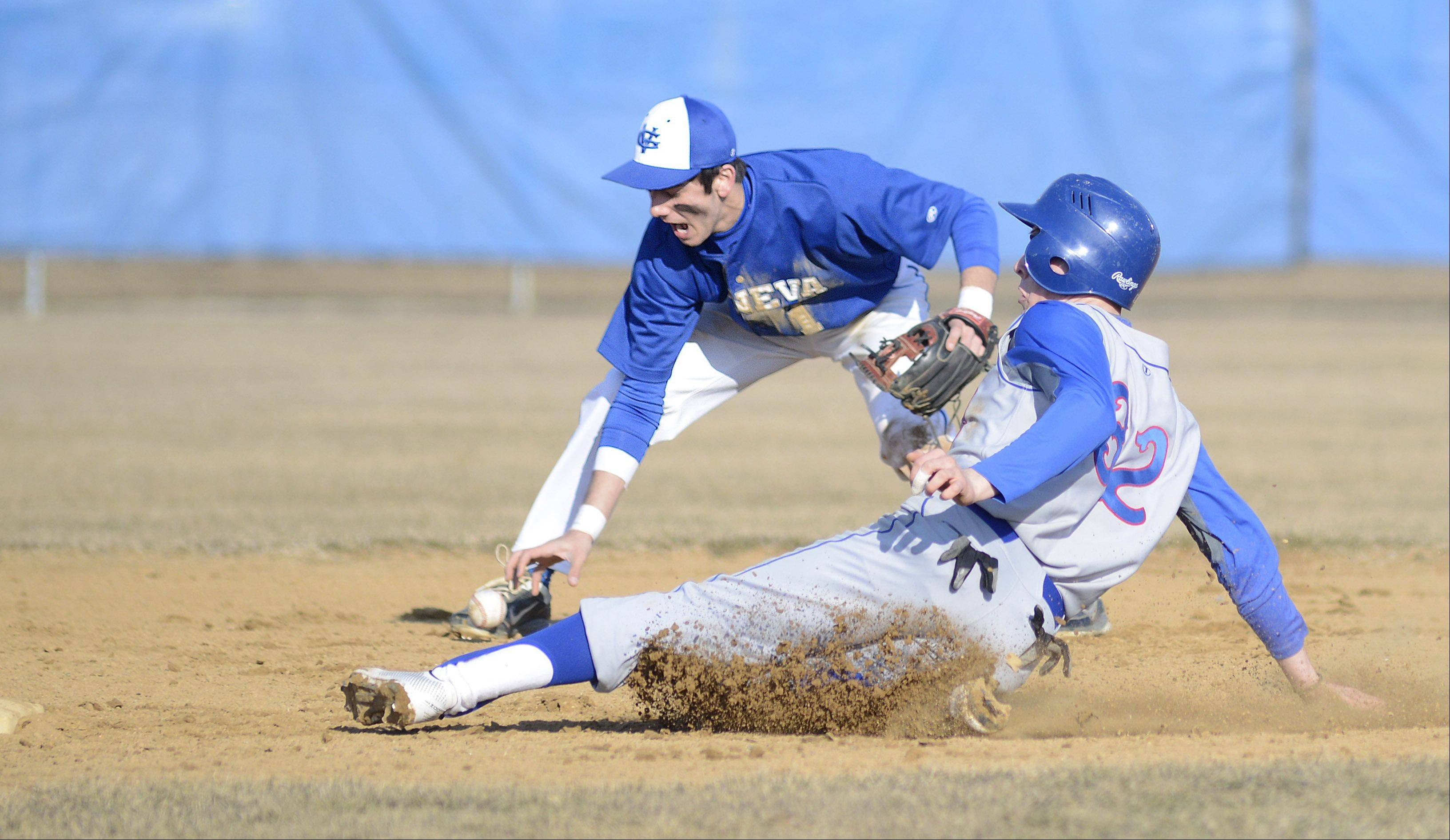 Marmion's Edgar Sanchez is safe on second after the ball bounces away from Geneva's Luke Polishak's hand in the fourth inning on Thursday, March 28.