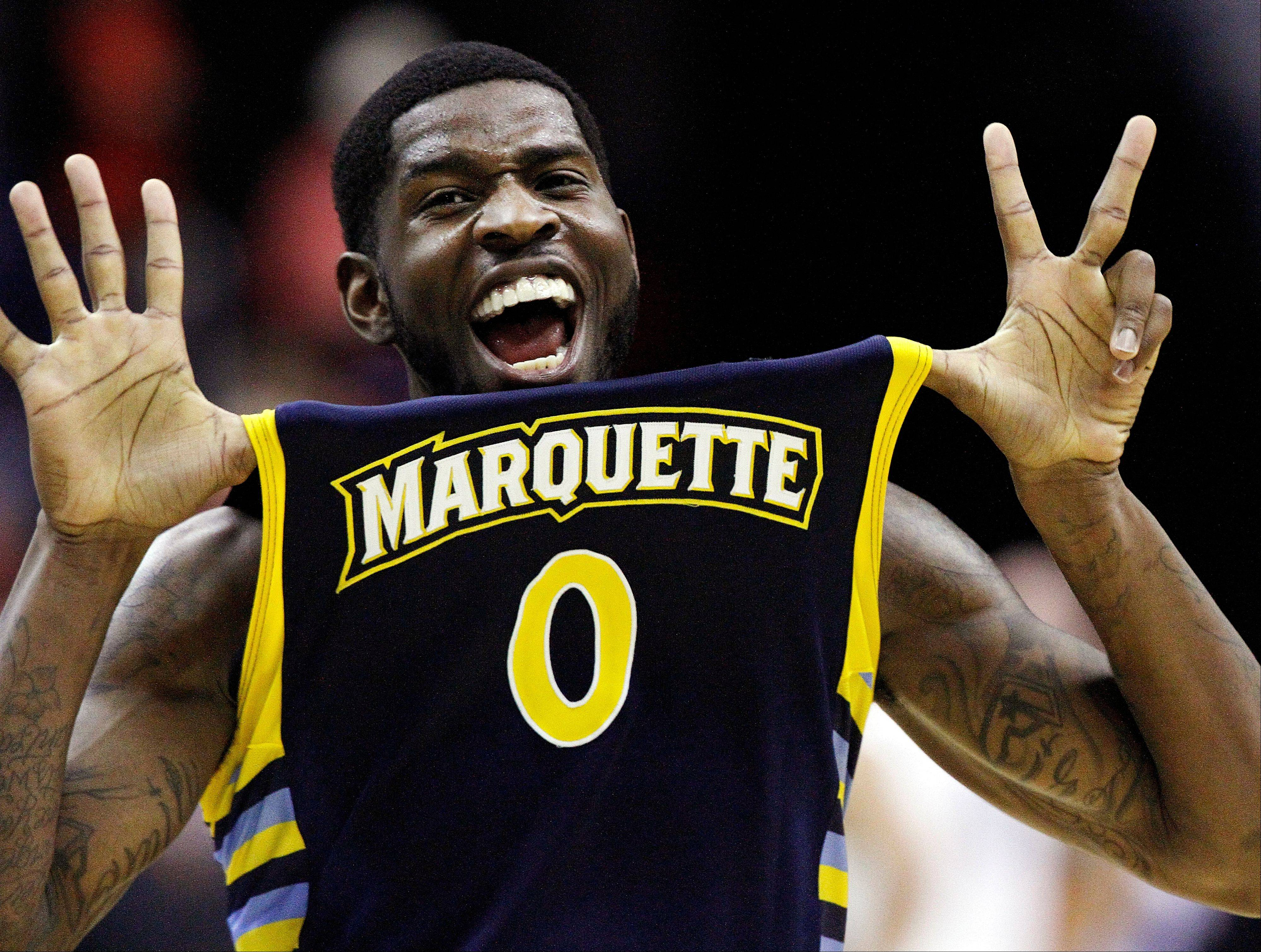 Marquette forward Jamil Wilson (0) celebrates their 71-61 win over Miami in an East Regional semifinal in the NCAA college basketball tournament, Thursday, March 28, 2013, in Washington. Wilson scored 16 points in the victory.