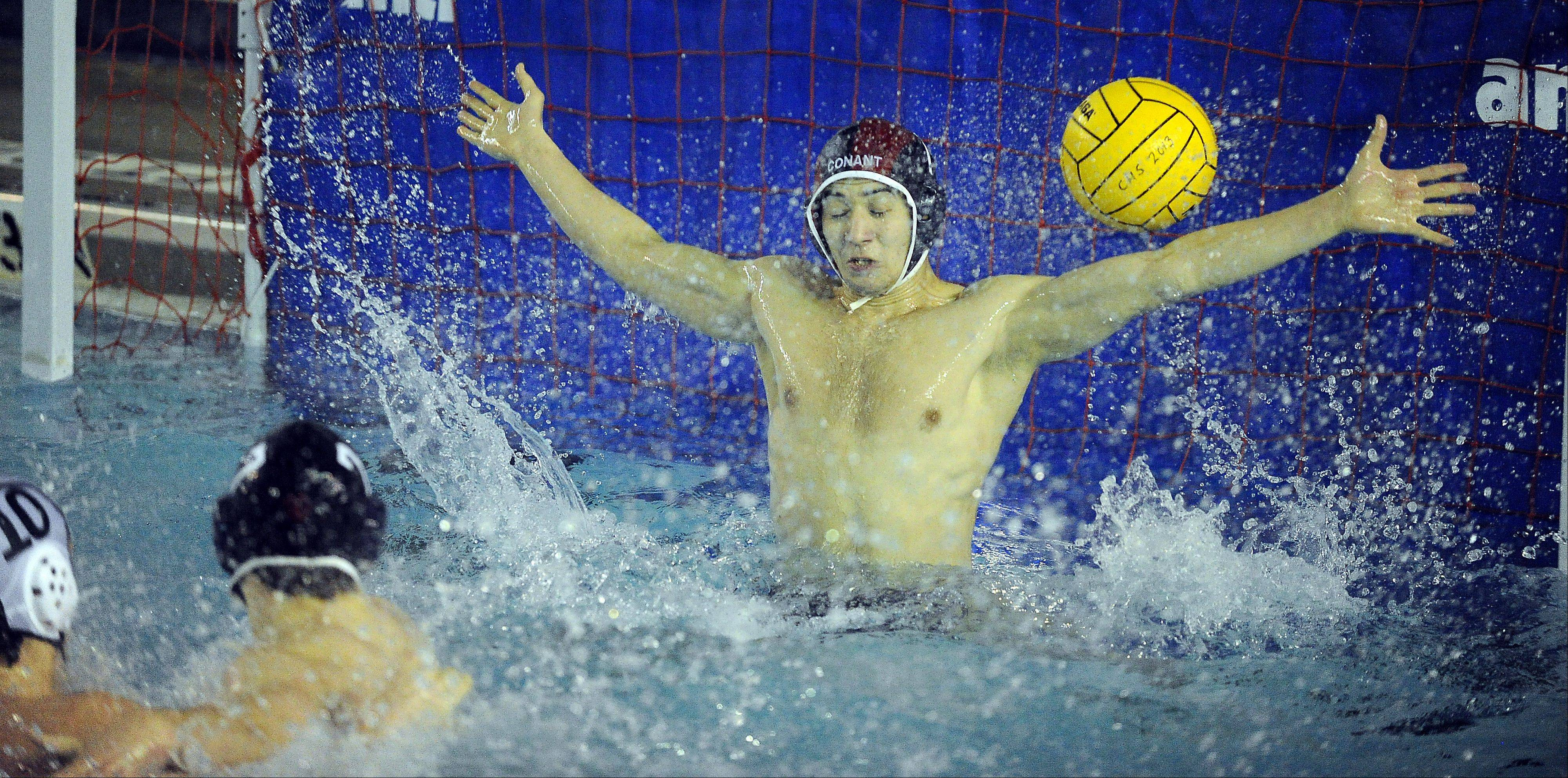 Conant's goalie Aly Ahmed attempts to stop a shot from Fremd in a recent game at Conant.