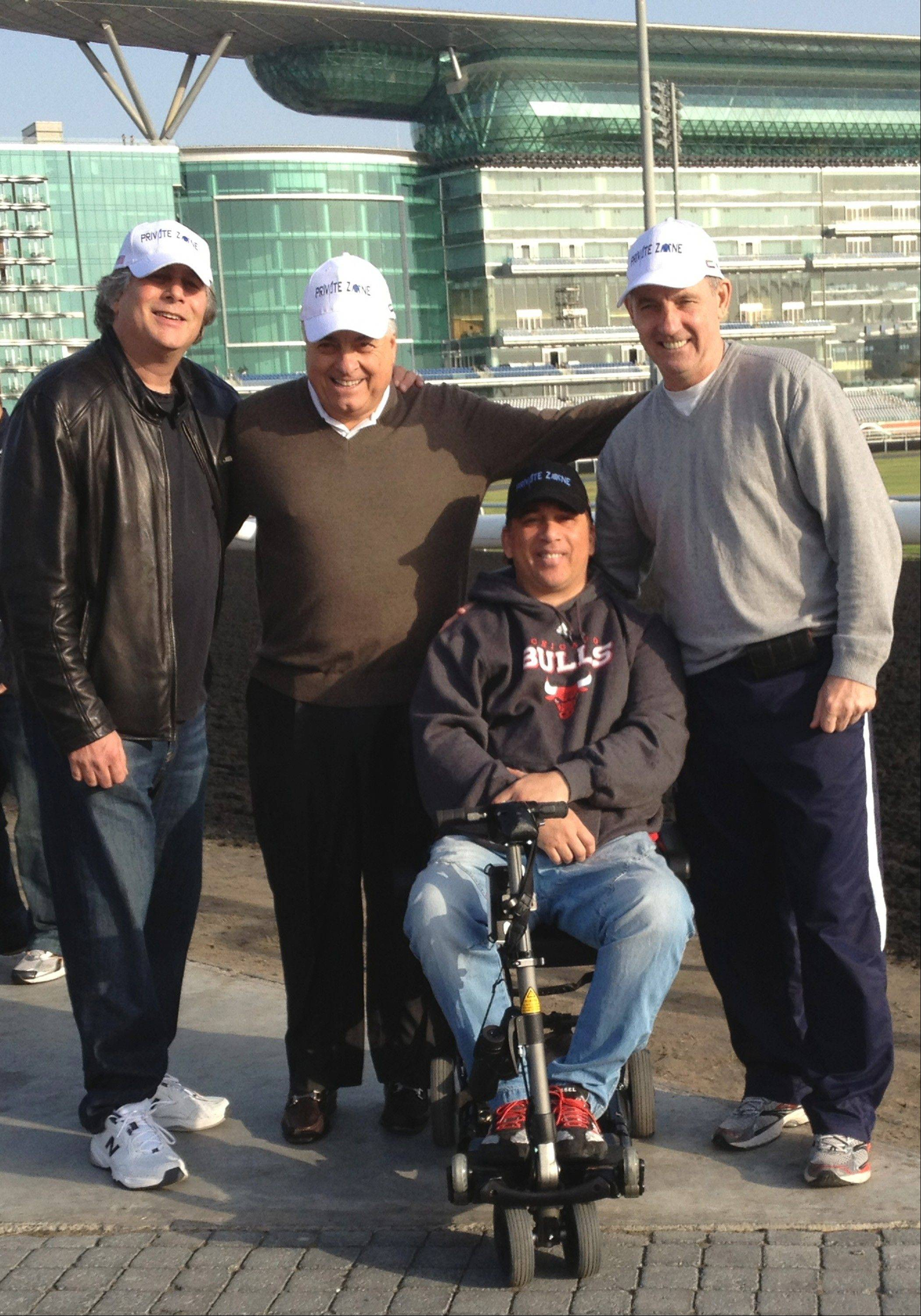 Four members of Good Friends Stable check out the Meydan Racecourse in Dubai, where they'll watch their horse, Private Zone, in a $2 million race. Left to right: Hilton Gordon, Joe Casciato, former jockey Rene Douglas and former Blackhawks star Denis Savard.