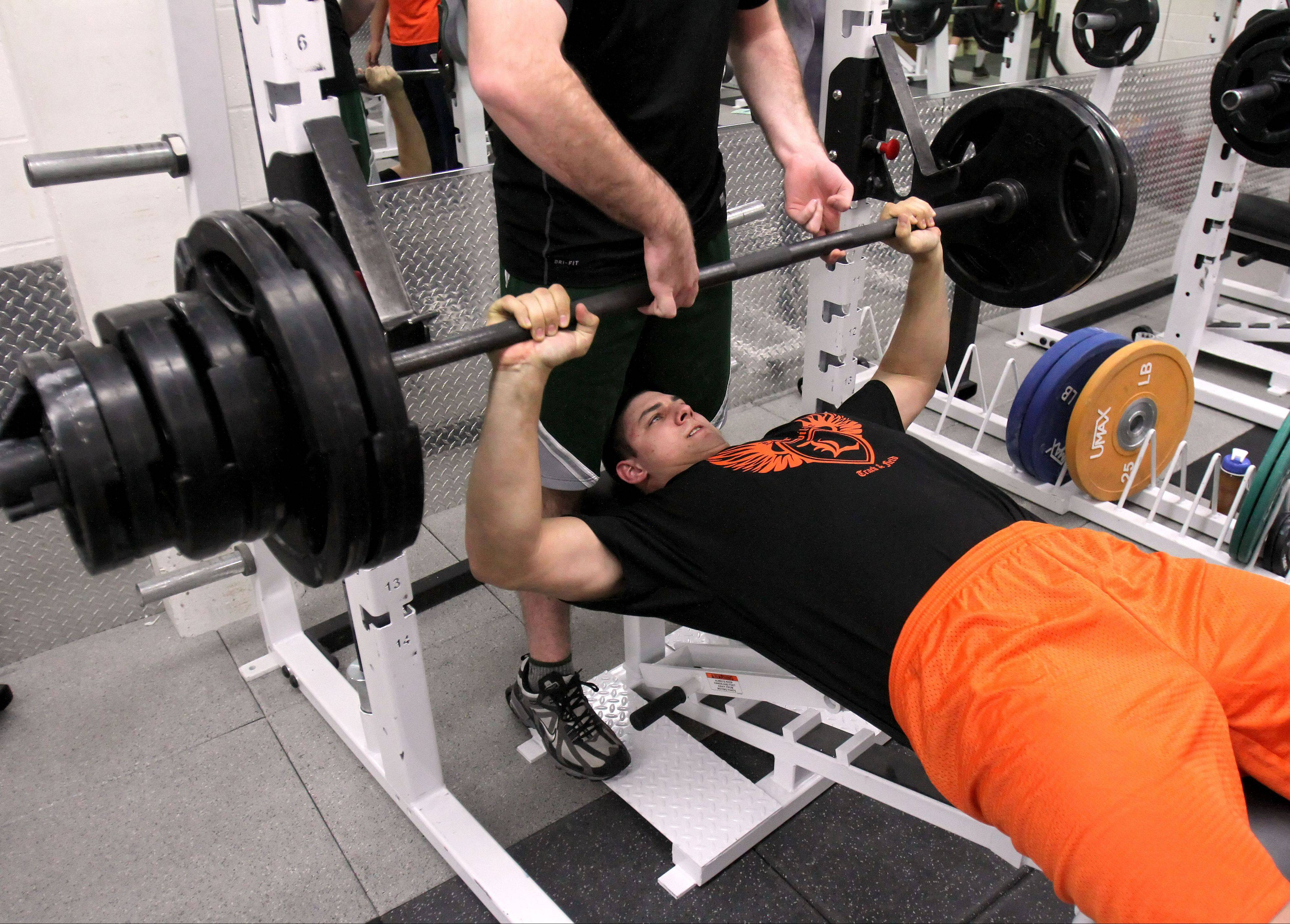 Libertyville thrower Mattsen Dziedzic bench presses 365 pounds as he works out at the high school.