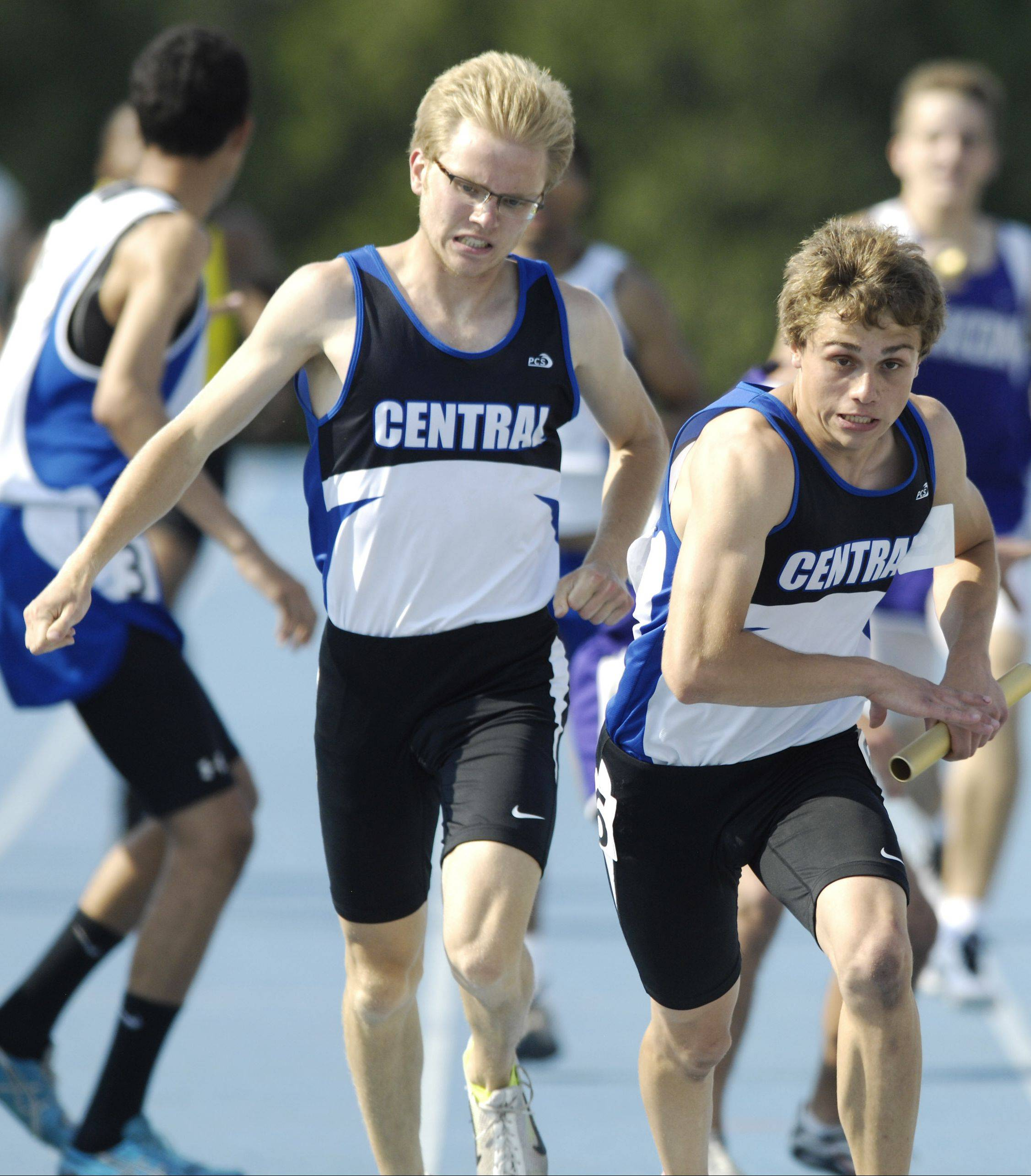Burlington Central's Ryan Olsen takes the baton from teammate Clint Kliem in the Class 2A 1,600-meter relay during the IHSA boys state track finals in Charleston last year.