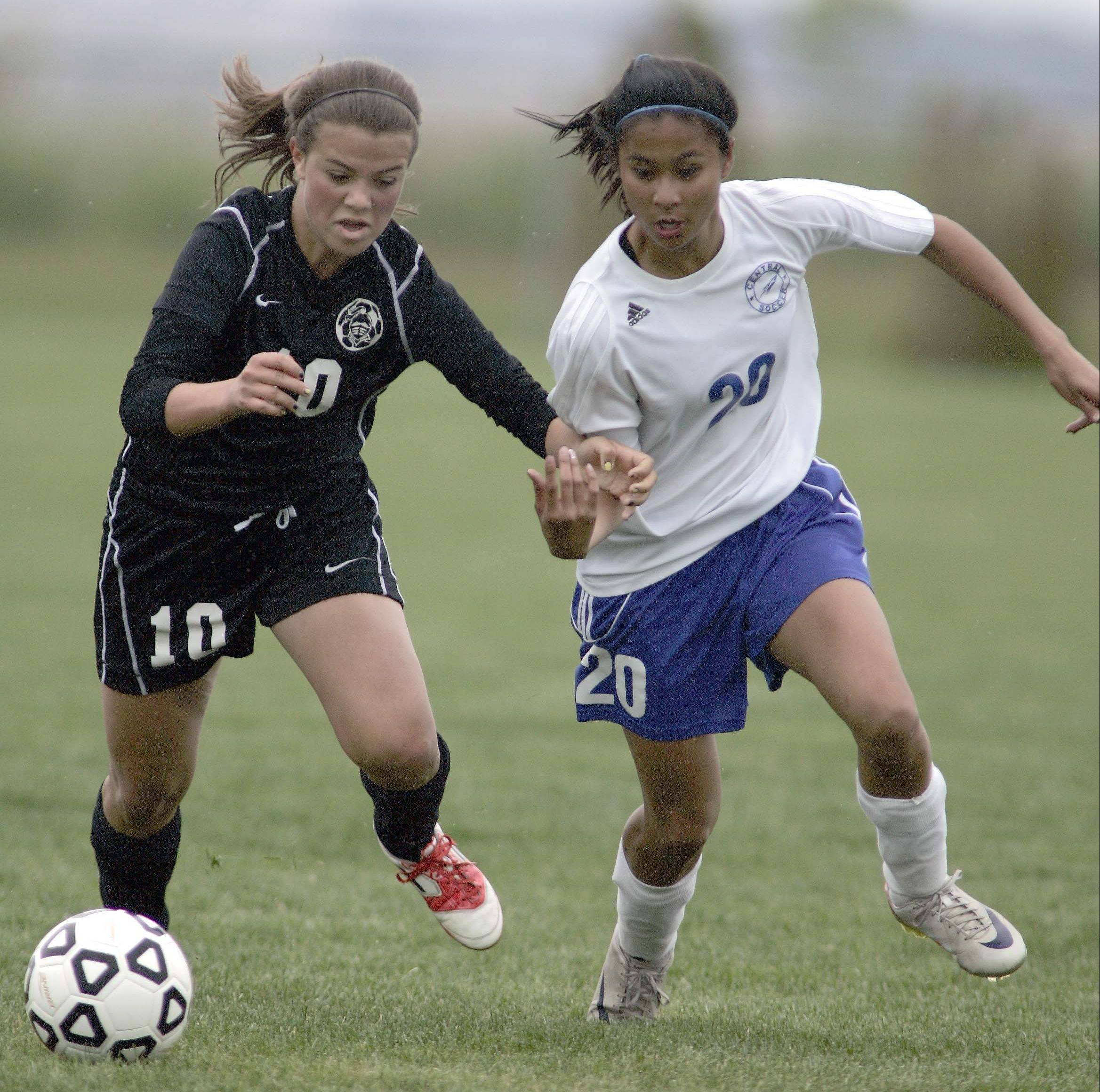 Burlington's Camille Delacruz (20), a Northern Iowa signee, pushes past Kaneland's Michelle Ortiz during a game last season.