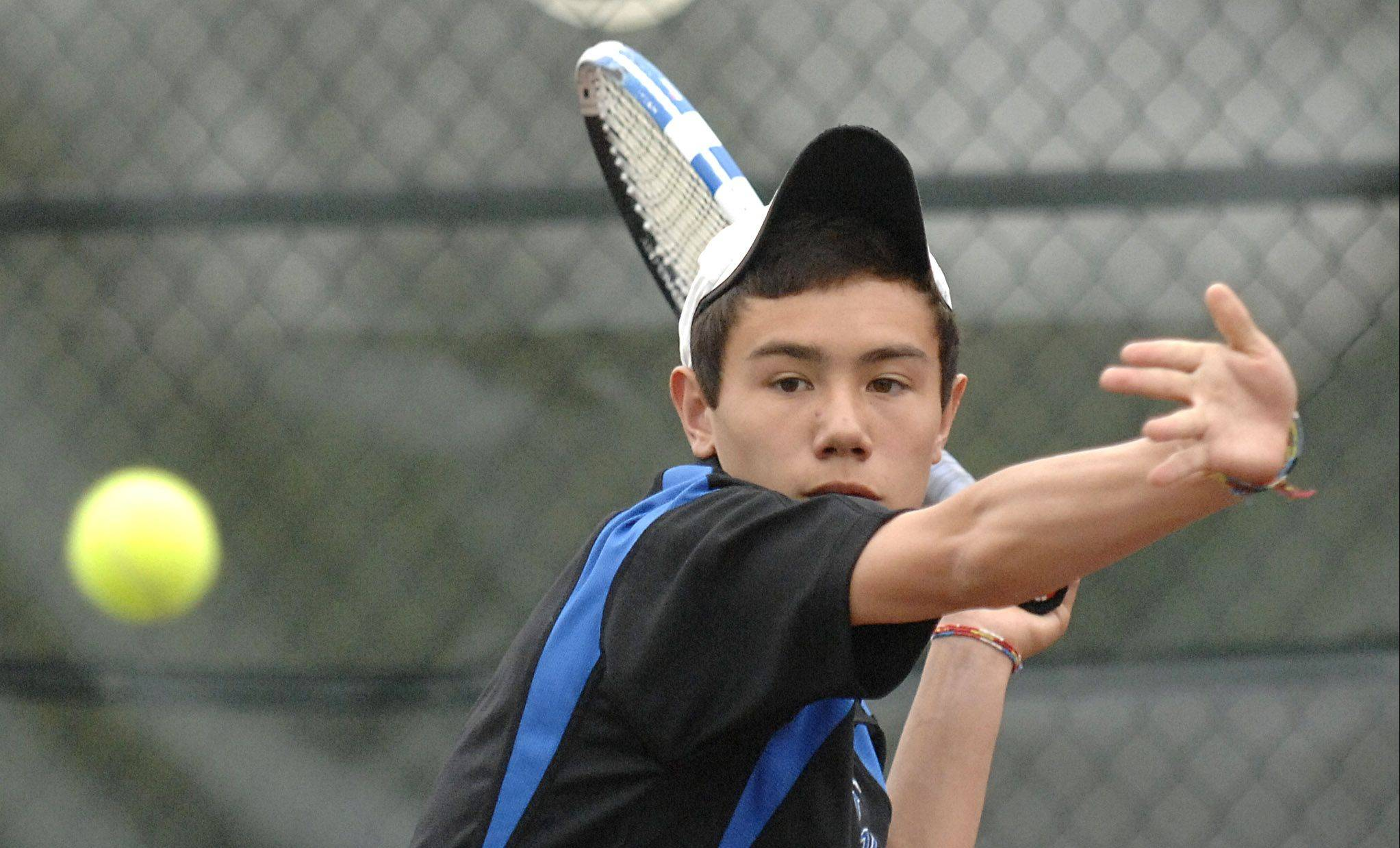 Geneva's Nick Huang returns a sever from IMSA's Suraj Sinha in a second singles match on Saturday, April 14.