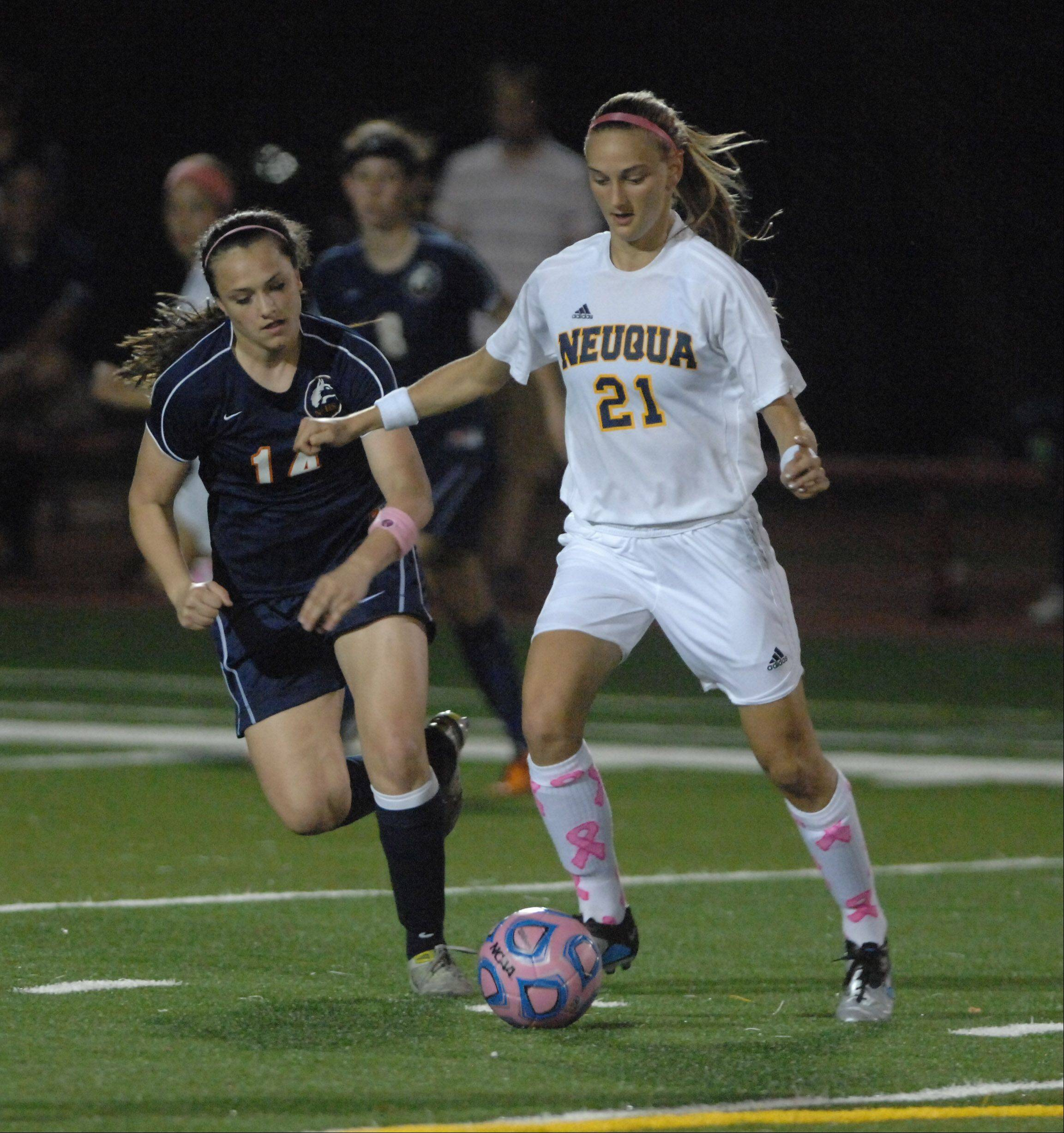 Paul Michna/pmichna@dailyherald.com � Christa Szalach of Naperville North,left, and Gianna Dal Pozzo of Neuqua play in the Naperville North vs. Neuqua Valley girls soccer game at North Central College Wednesday.