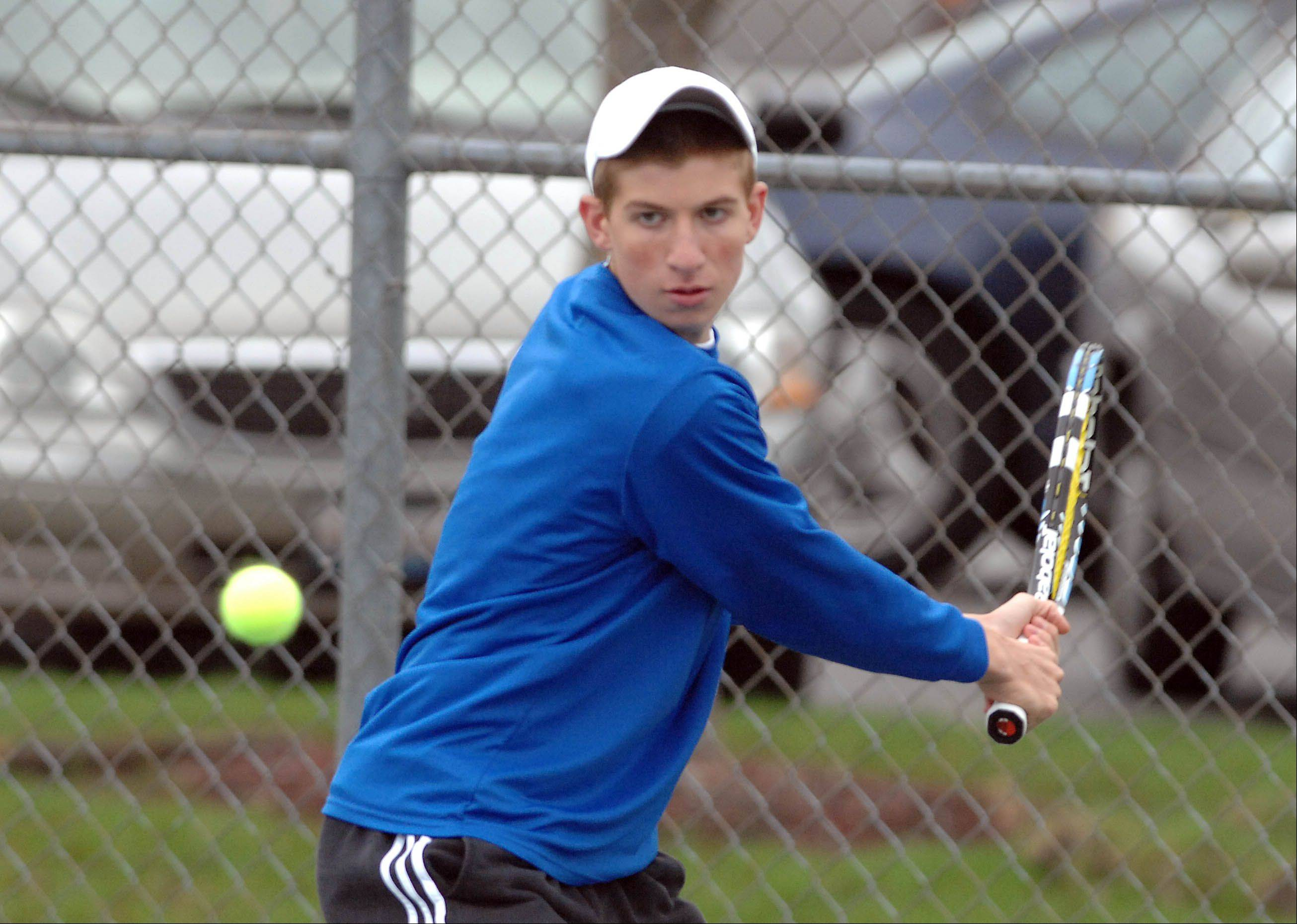 Eric Marbach of Waubonsie during the Lake Park at Waubonsie Valley boys tennis meet Thursday. � �
