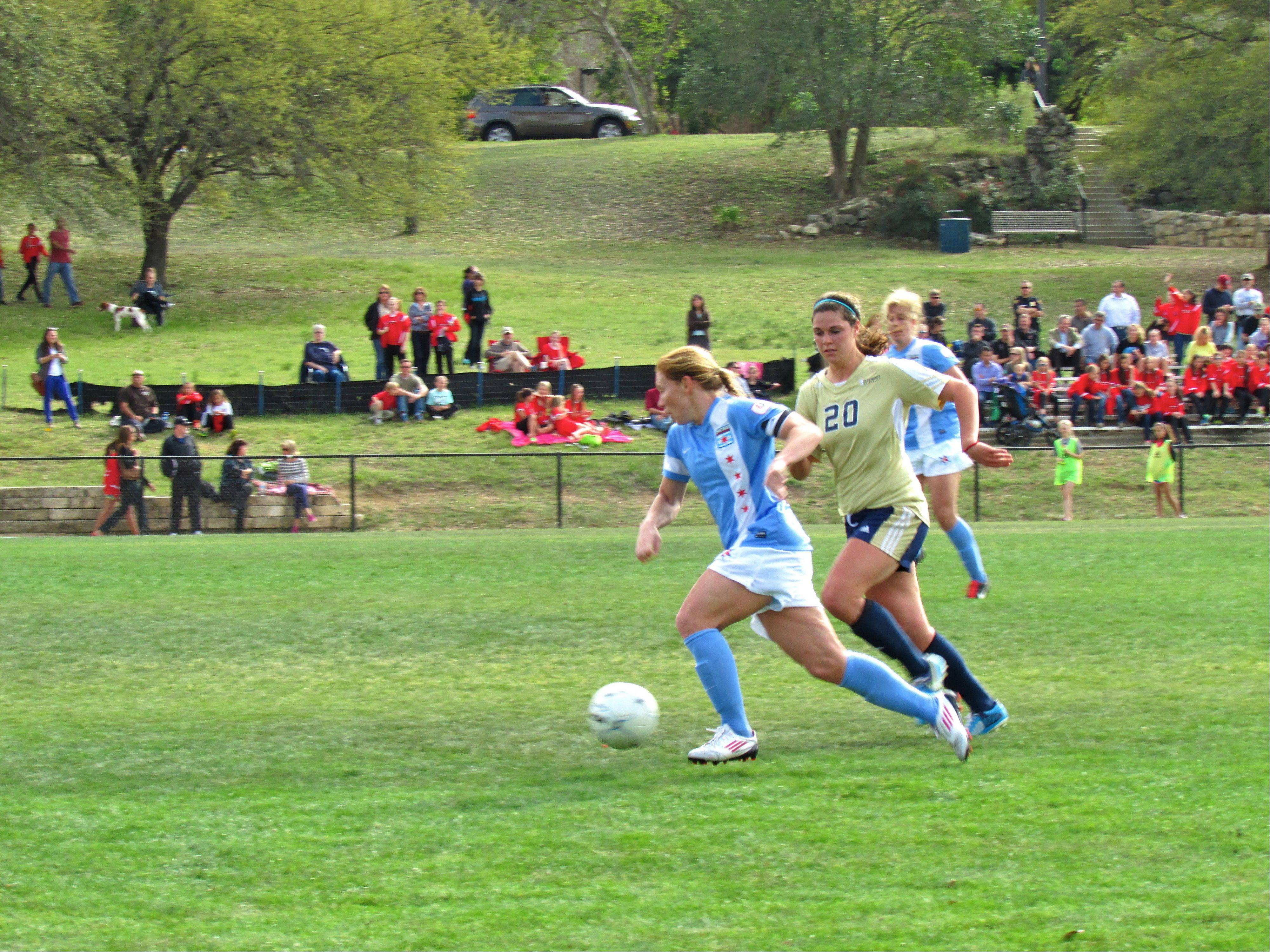 Chicago Red Stars midfielder/forward Lori Chalupny scored two goals Wednesday in the NWSL team's 8-0 exhibition match against St. Edward's University in Austin, Texas.