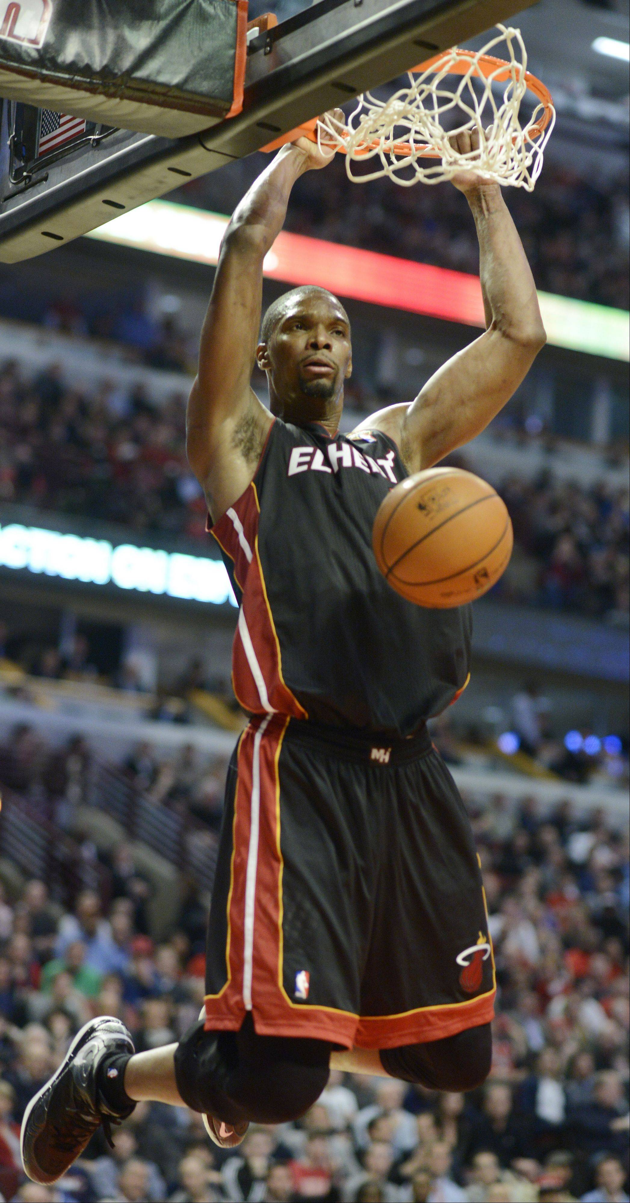 Chris Bosh of the Heat dunks during Wednesday's game against the Bulls.