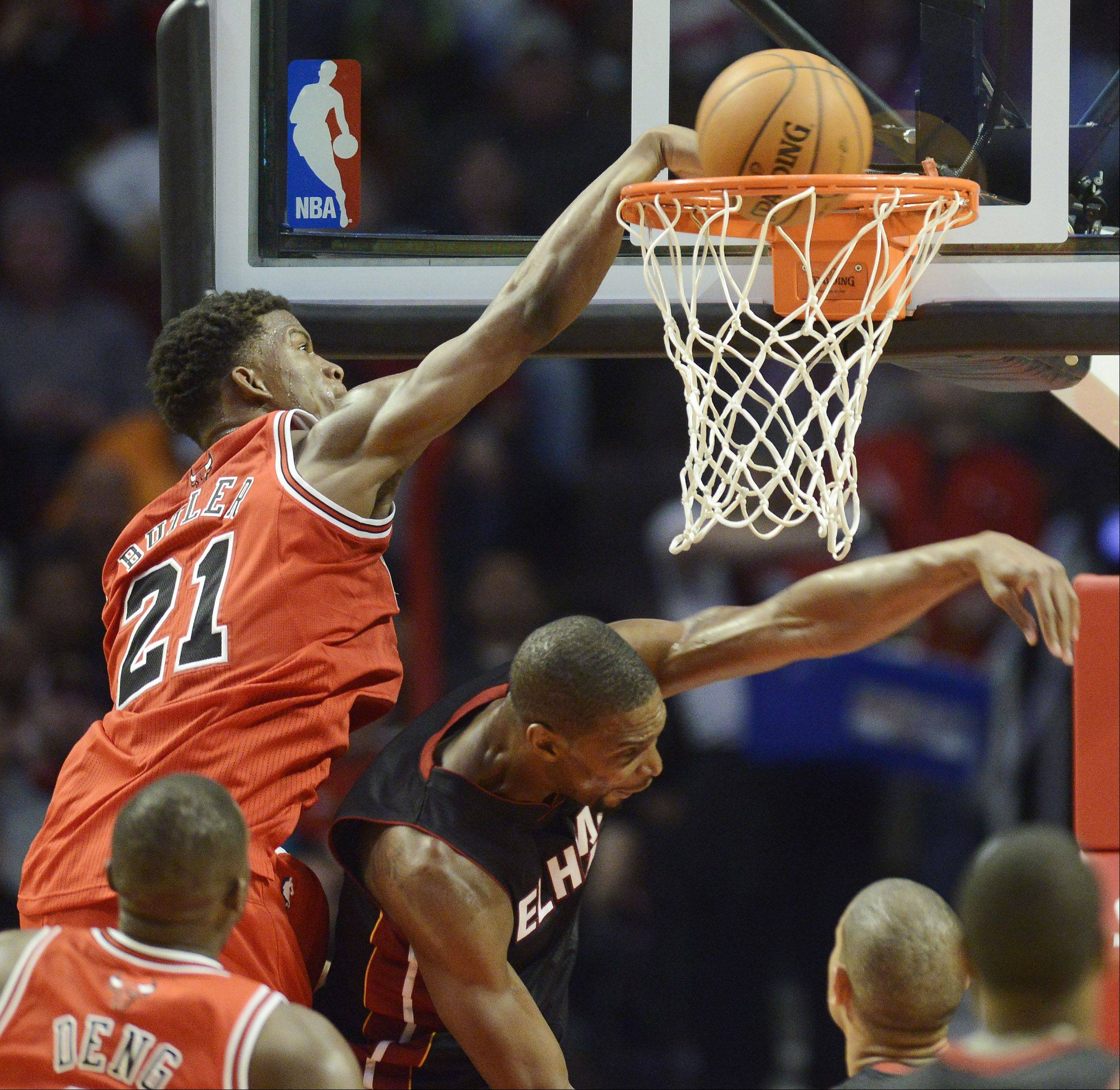 Jimmy Butler of the Bulls dunks over Chris Bosh of the Heat with 2:25 left in the third quarter Wednesday.