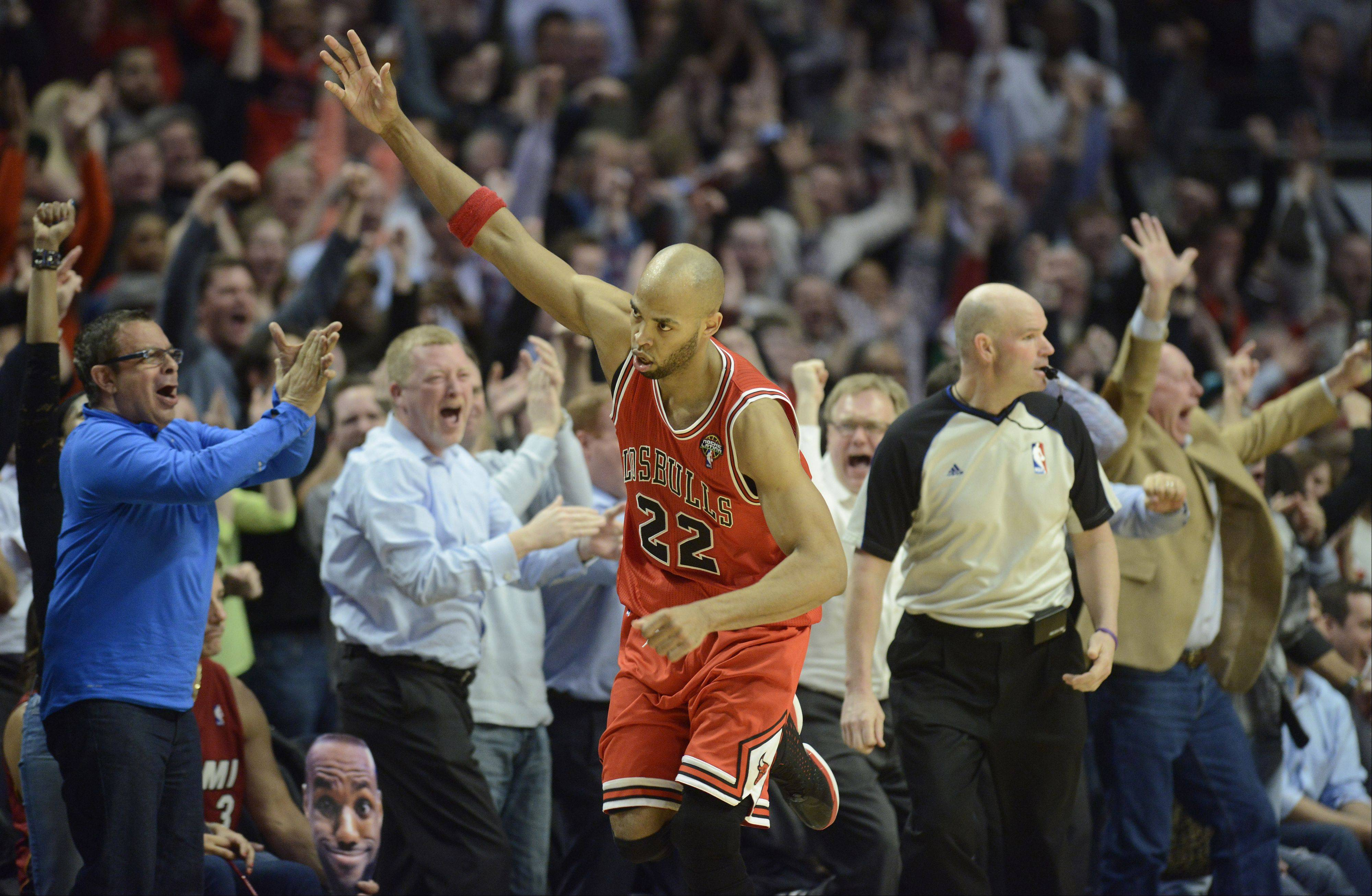 Taj Gibson of the Bulls celebrates a shot from the corner during the fourth quarter against the Miami Heat.
