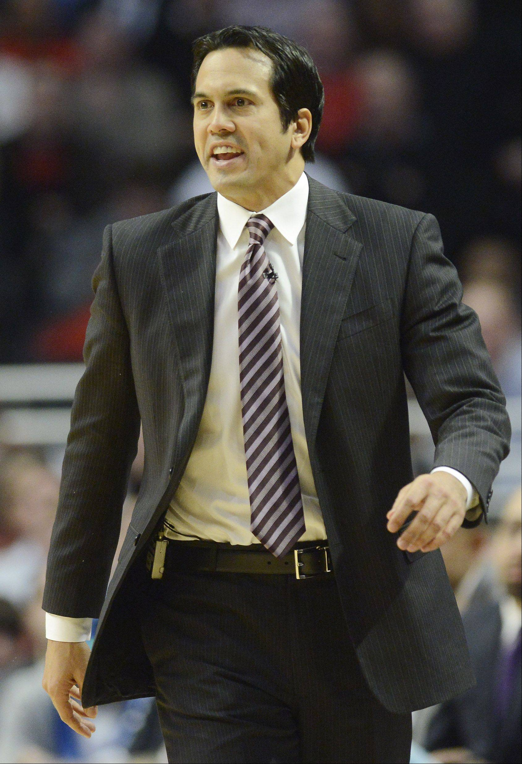 Miami Heat coach Erik Spoelstra leads his team during Wednesday's game against the Bulls.