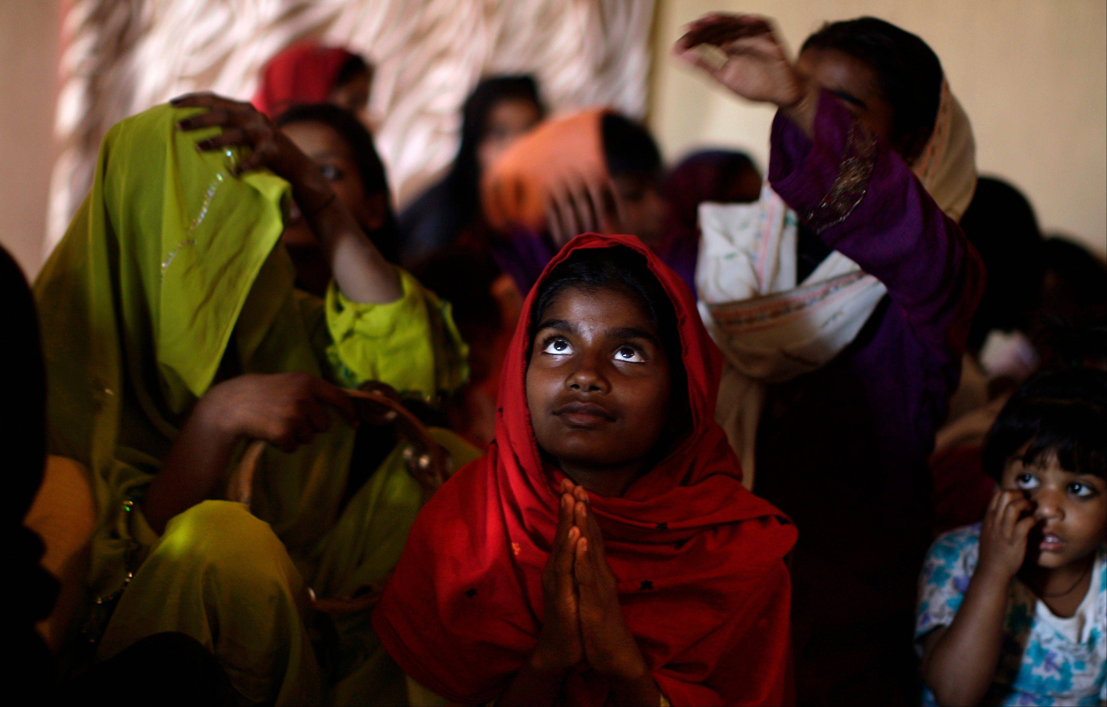 Pakistani Christians pray Friday during a Mass on Good Friday in a church in Islamabad, Pakistan. Christians around the world are marking the Easter holy week.