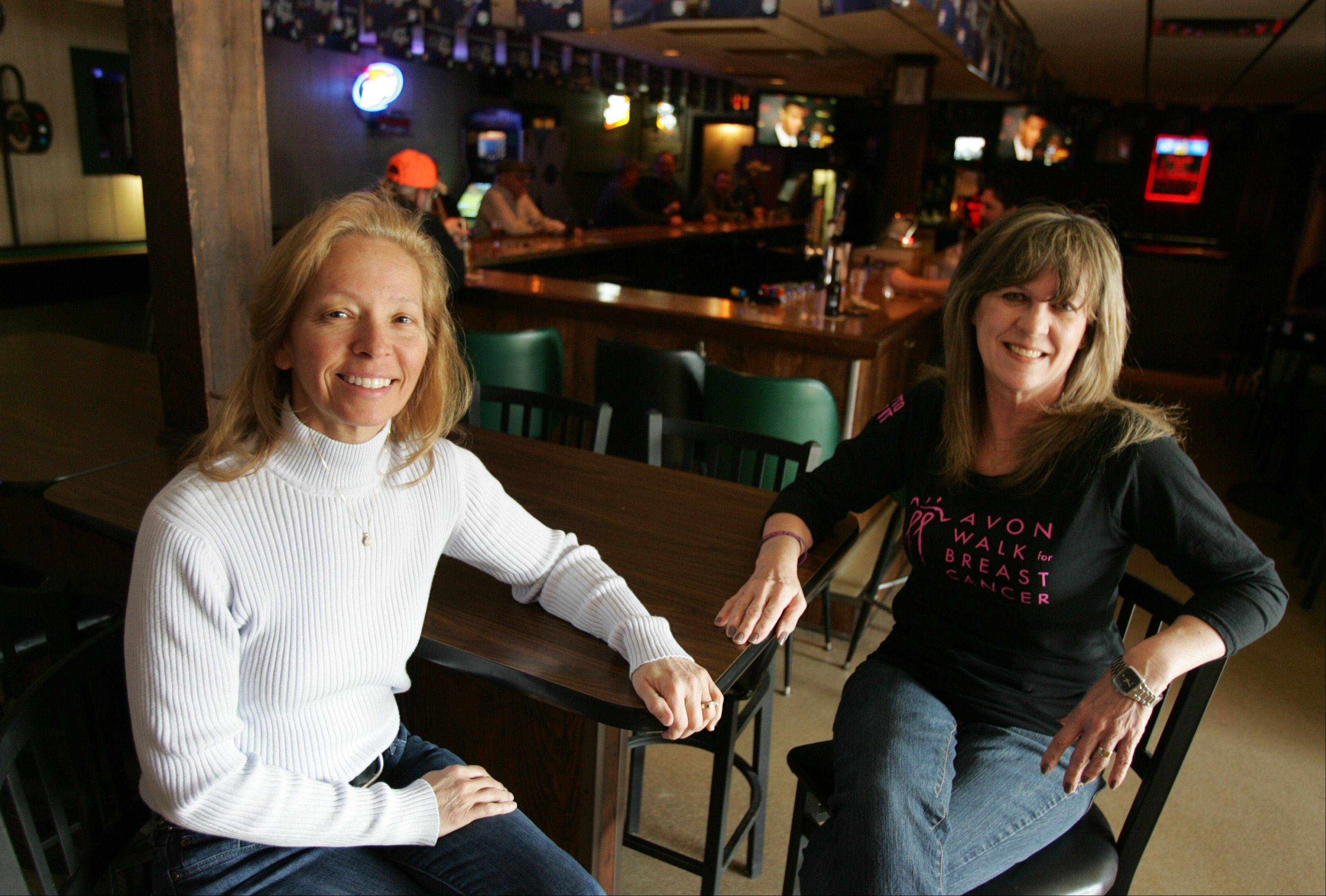 Hoppe's Tavern owner Jill Hoppe, left, has been teaming up with breast cancer walker Nancy Belanger to help raise money by hosting fundraisers for the last seven years at the bar on Elgin's east side.