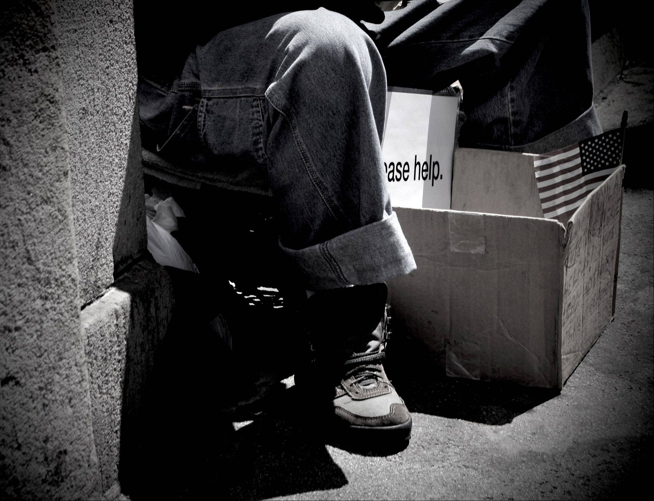 A man looks for a helping hand in Chicago during the summer of 2012.