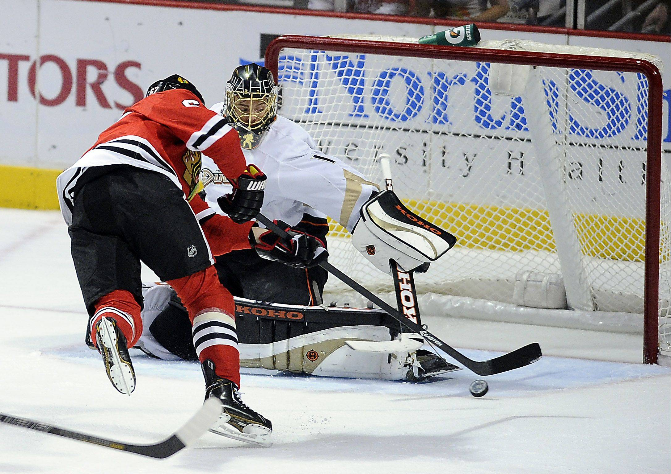 Mark Welsh/mwelsh@dailyherald.com Blackhawks Michael Frolik with a shot on goal against Anaheim's goalie Jonas Hiller that could have tied the game in the third period falls short at the United Center in Chicago on Friday.
