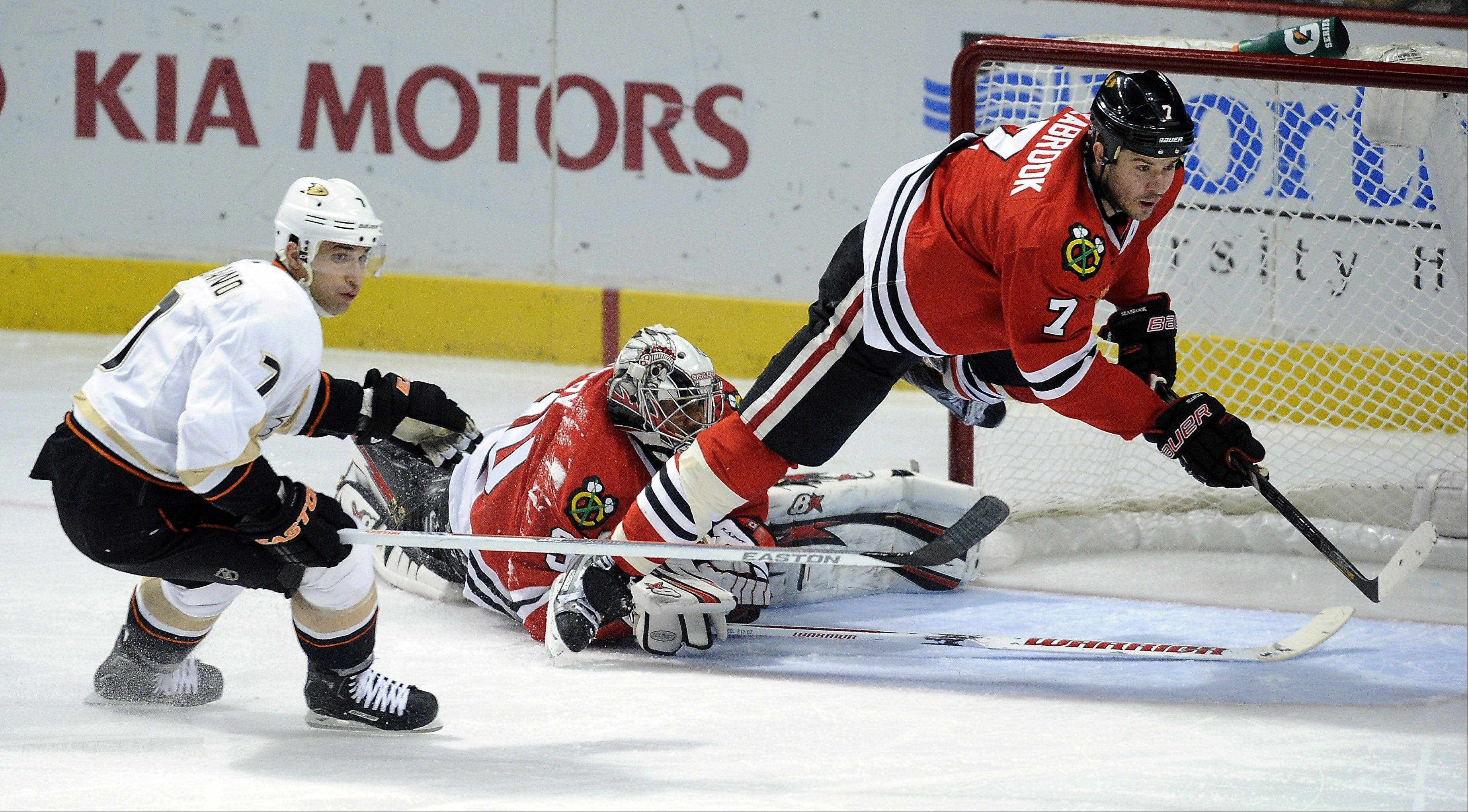 Mark Welsh/mwelsh@dailyherald.com Blackhawks Brent Seabrook gets tripped up in the second period as he tries for a loose puck at the United Center in Chicago on Friday.