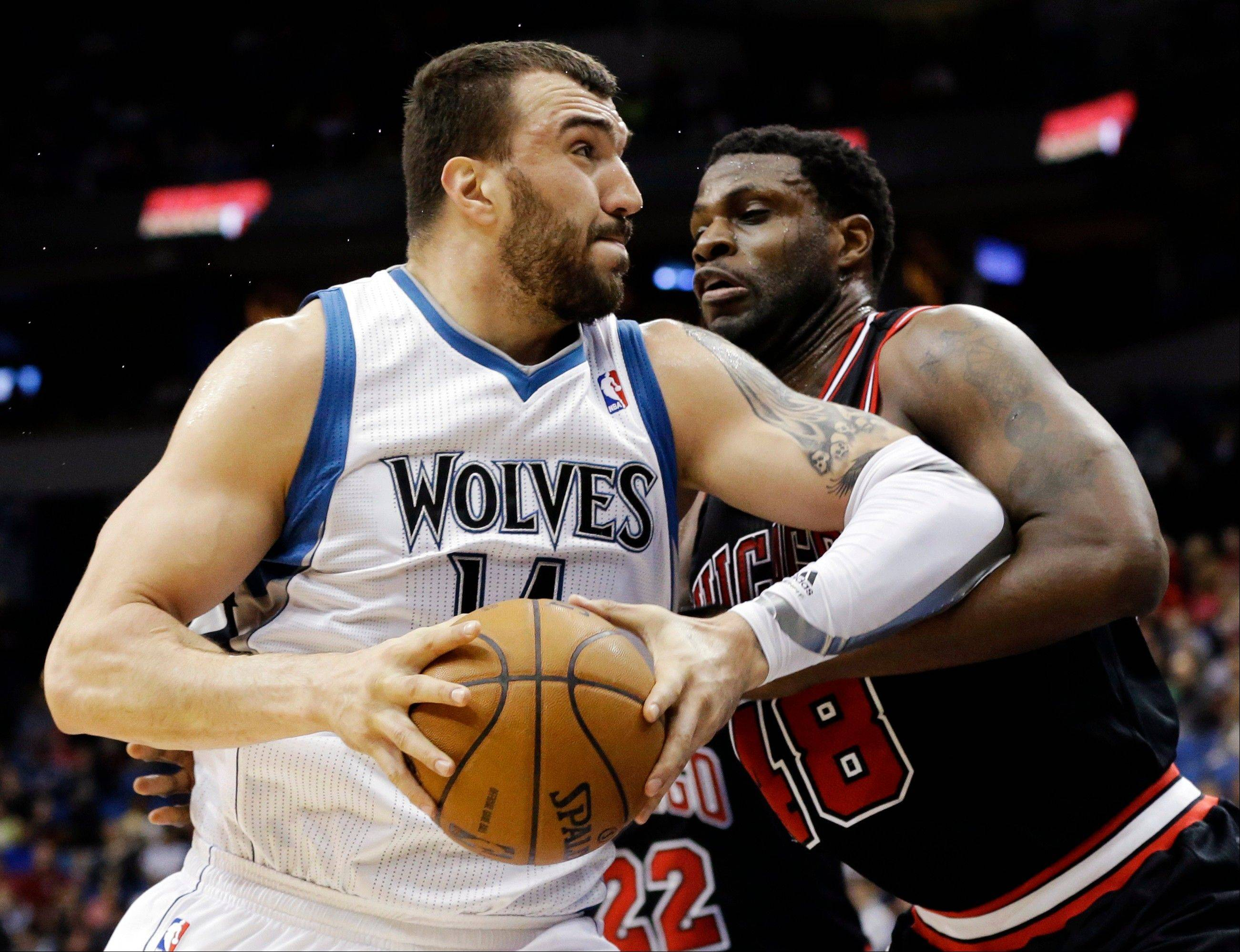 Minnesota Timberwolves� Nikola Pekovic, left, of Montenegro, drives against the Bulls� Nazr Mohammed in the first quarter of an NBA basketball game, Sunday, March 24, 2013, in Minneapolis.