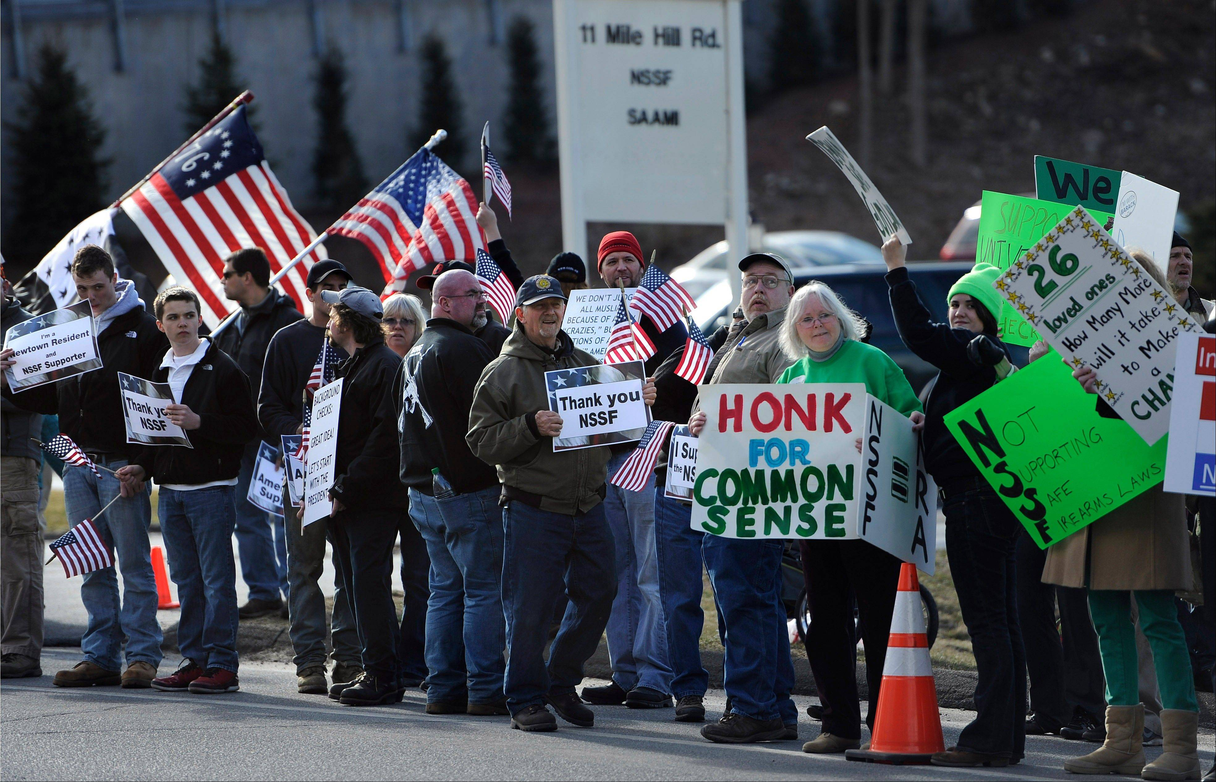 Supporters of both sides of the gun debate gather outside the National Shooting Sports Foundation headquarters Thursday in Newtown, Conn.