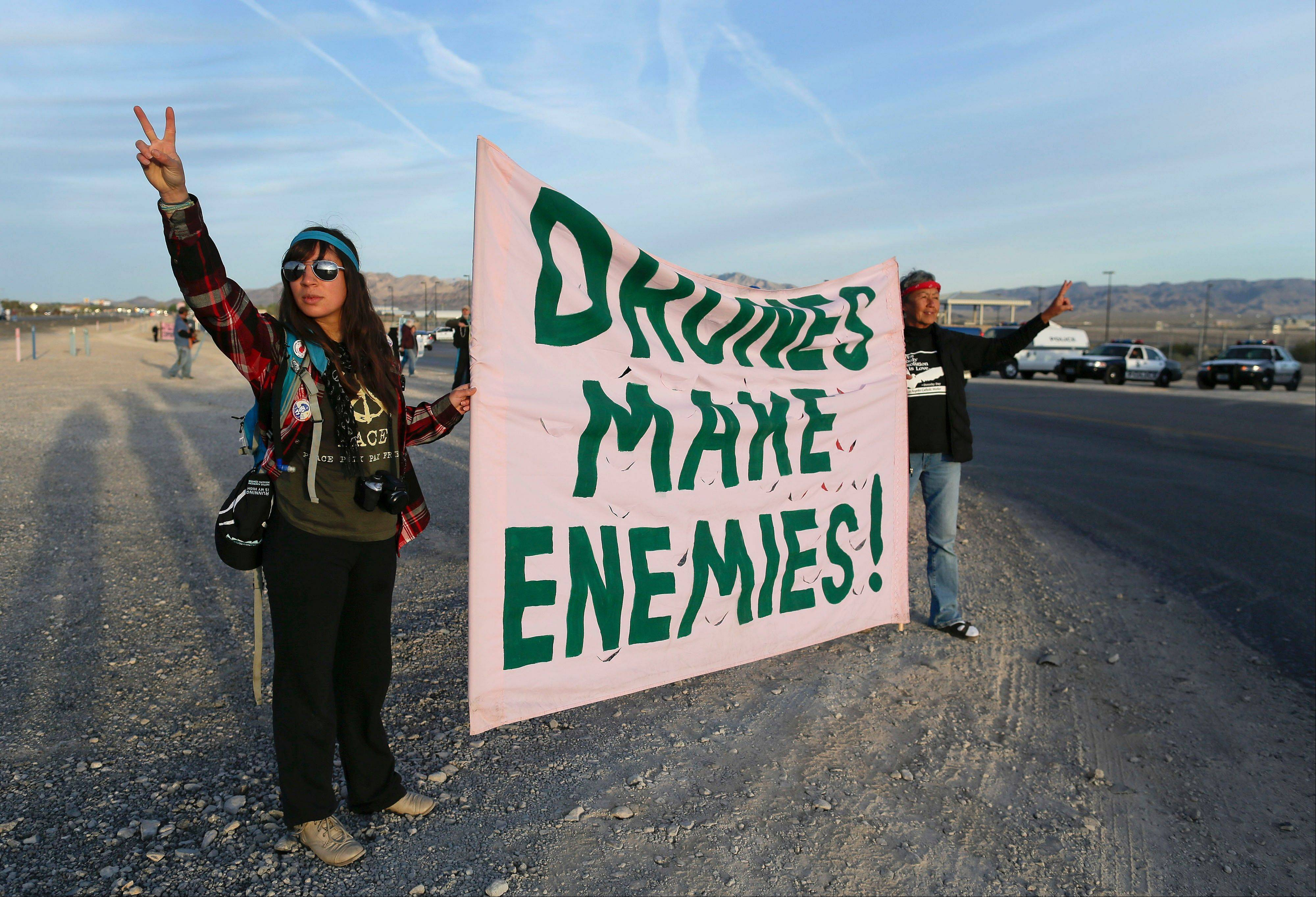 Demonstrators stand along the entrance Wednesday to Creech Air Force Base, home of the Predator and Reaper drones.