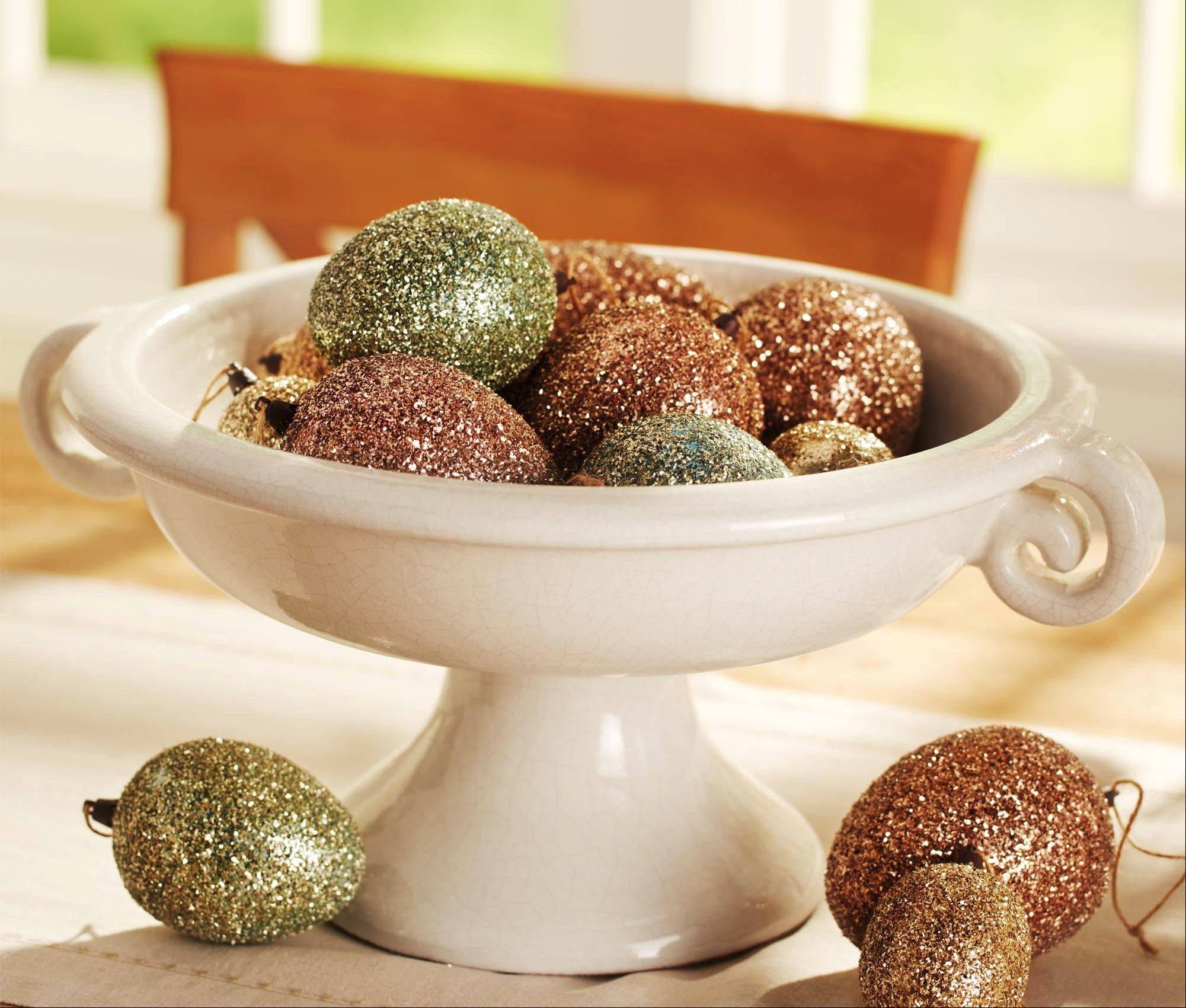 Glitter covered eggs from Pottery Barn bring some sophisticated glamour to the Easter table.