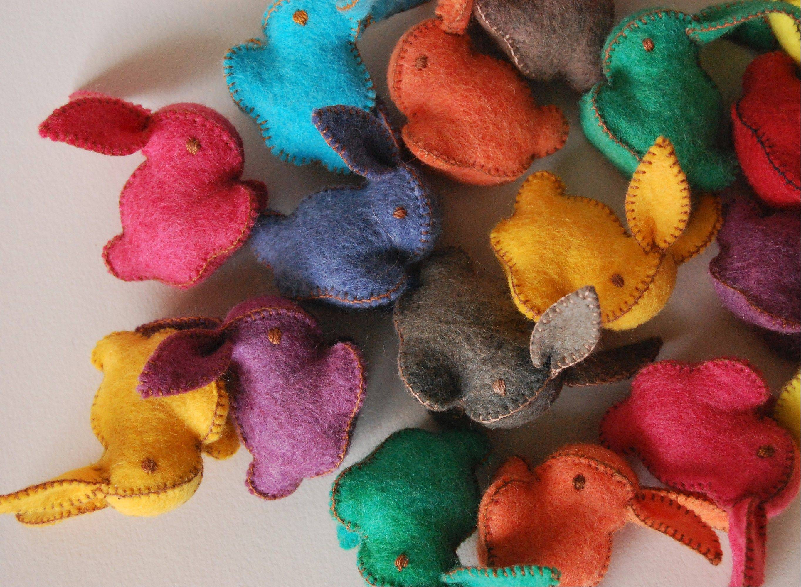 Canadian textile artist Cristina Larsen of Textile Platypus crafts stuffed felted bunnies and chicks in a rainbow of hues that can be found at www.etsy.com/shop/textileplatypus.