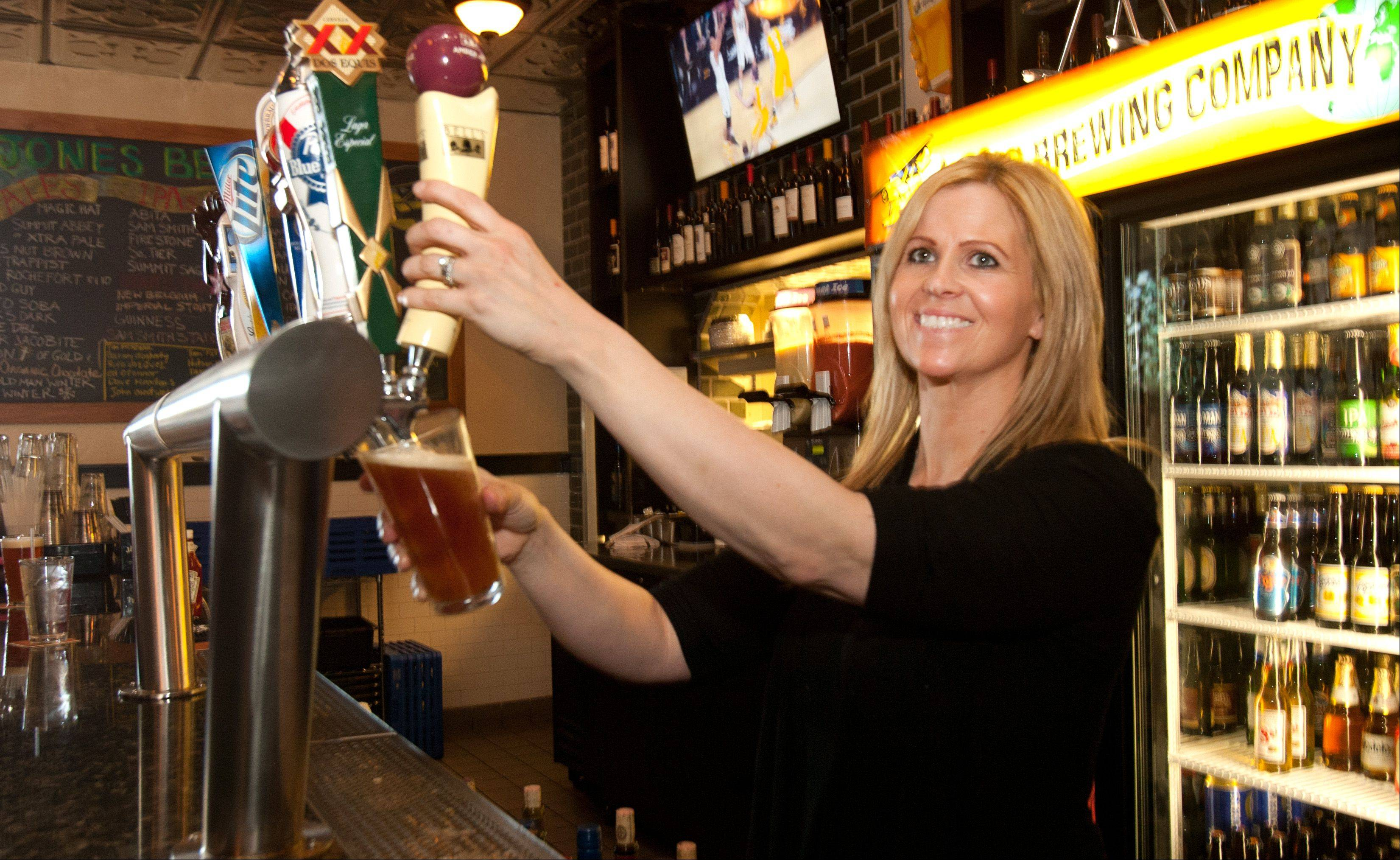 Amber Freeland serves beer at HB Jones in Elmhurst.