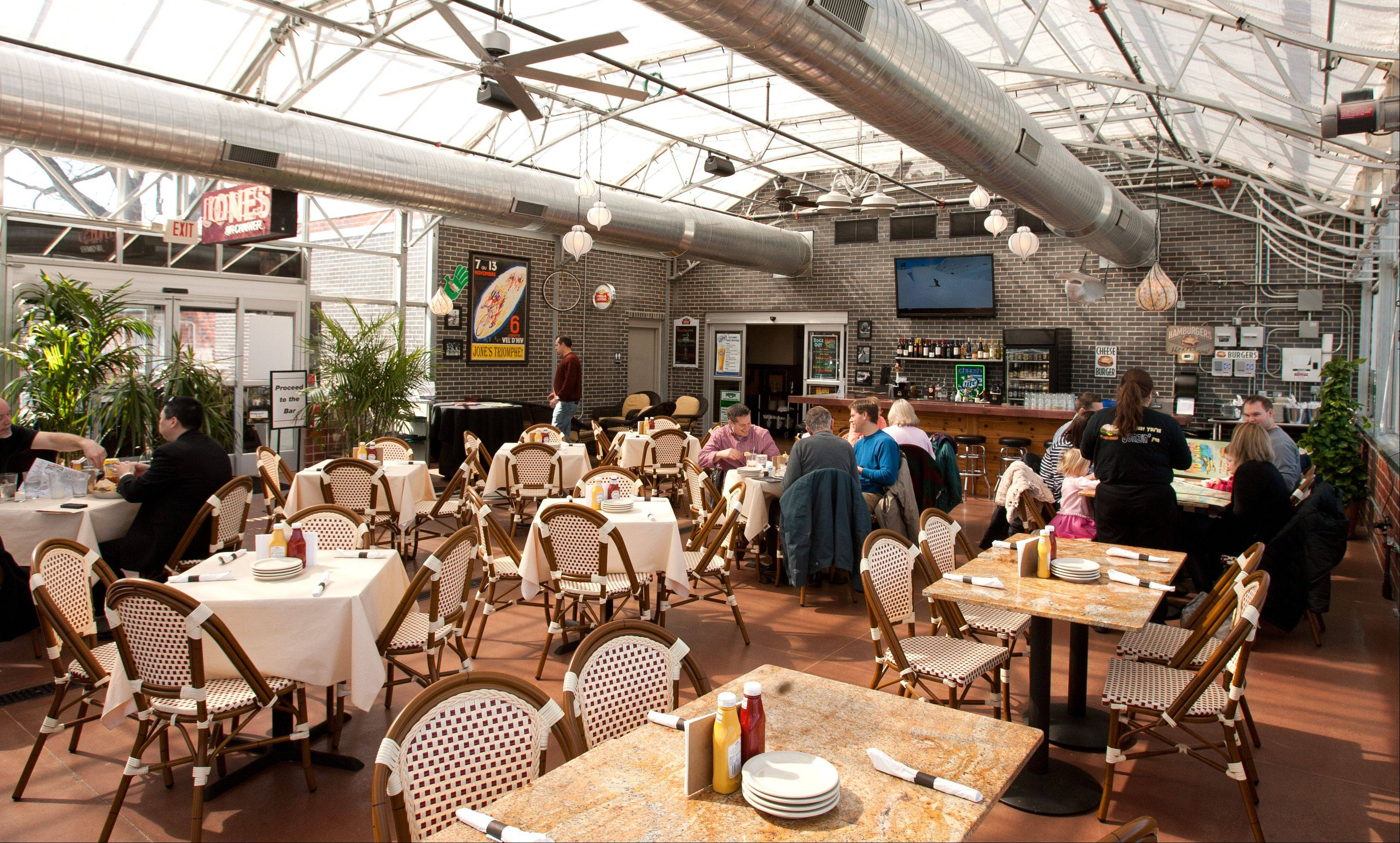 A past life as a greenhouse makes the dining area at HB Jones sunny and bright.